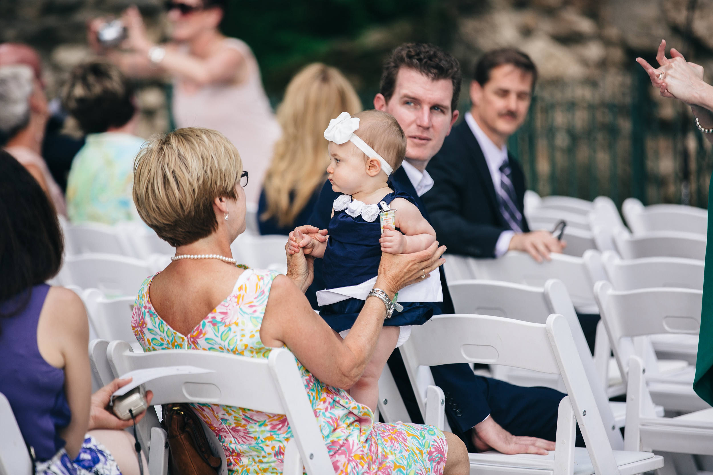 Wedding guests at ceremony at Nazareth Hall.