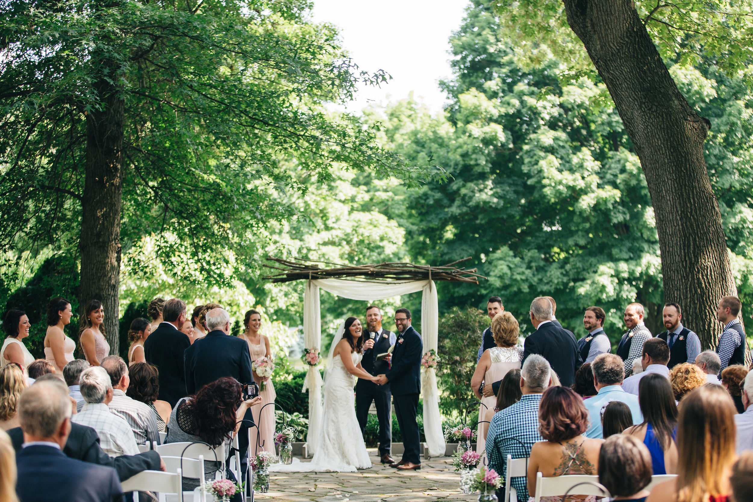 Bride and groom during ceremony at Hoover Park in Canton, Ohio.