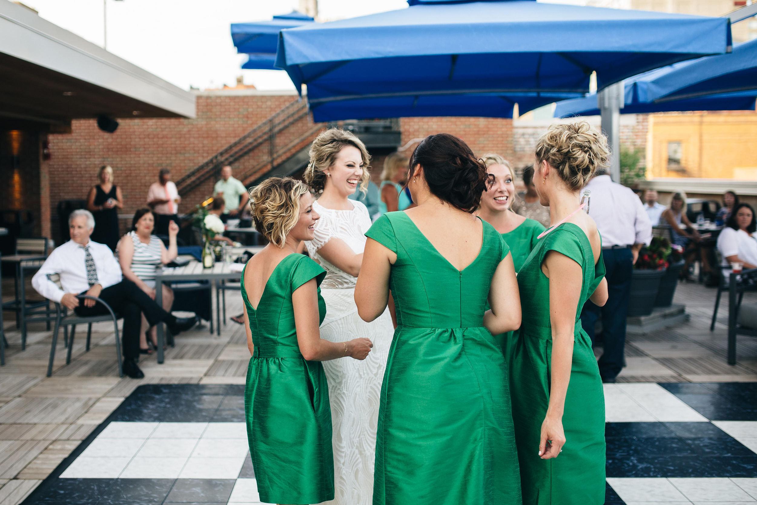 Bridesmaids dancing at wedding reception at Hensville in Toledo.