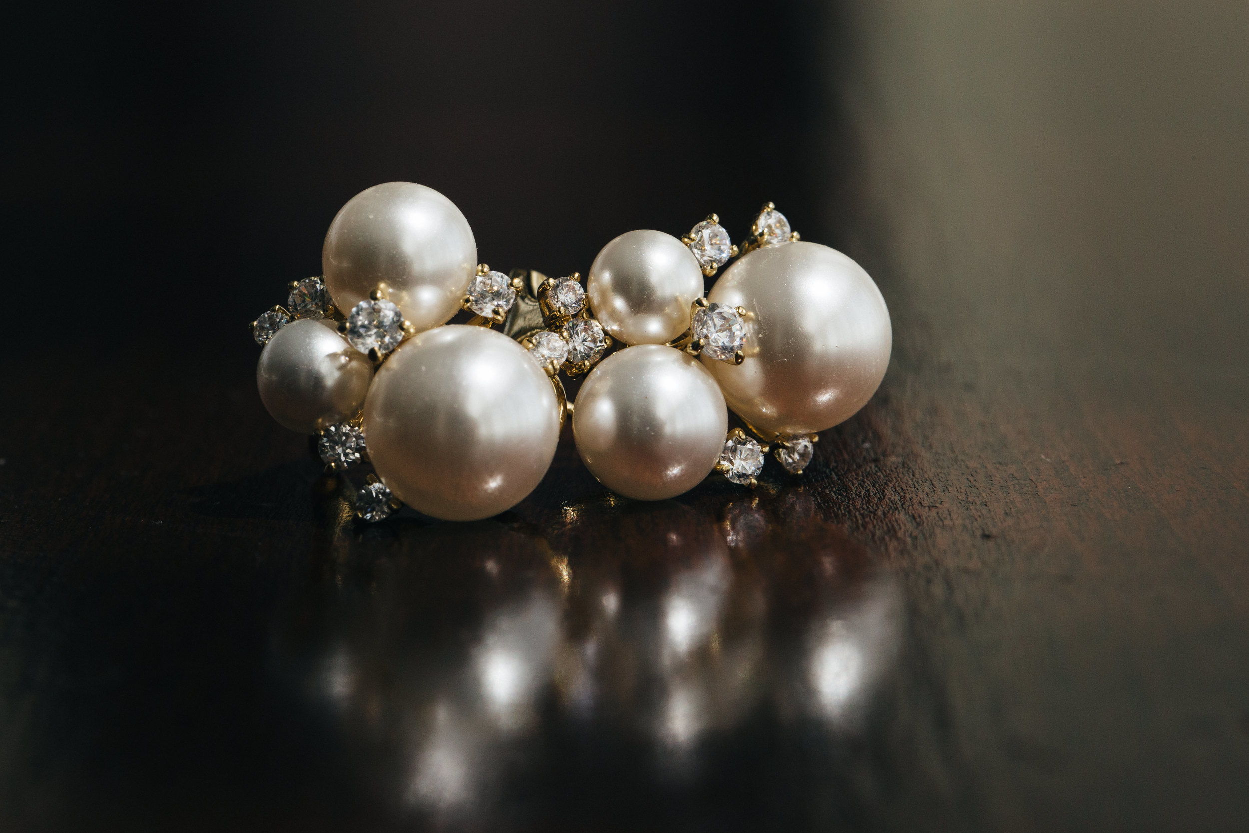 Pearl wedding earrings for bride in downtown Toledo wedding.