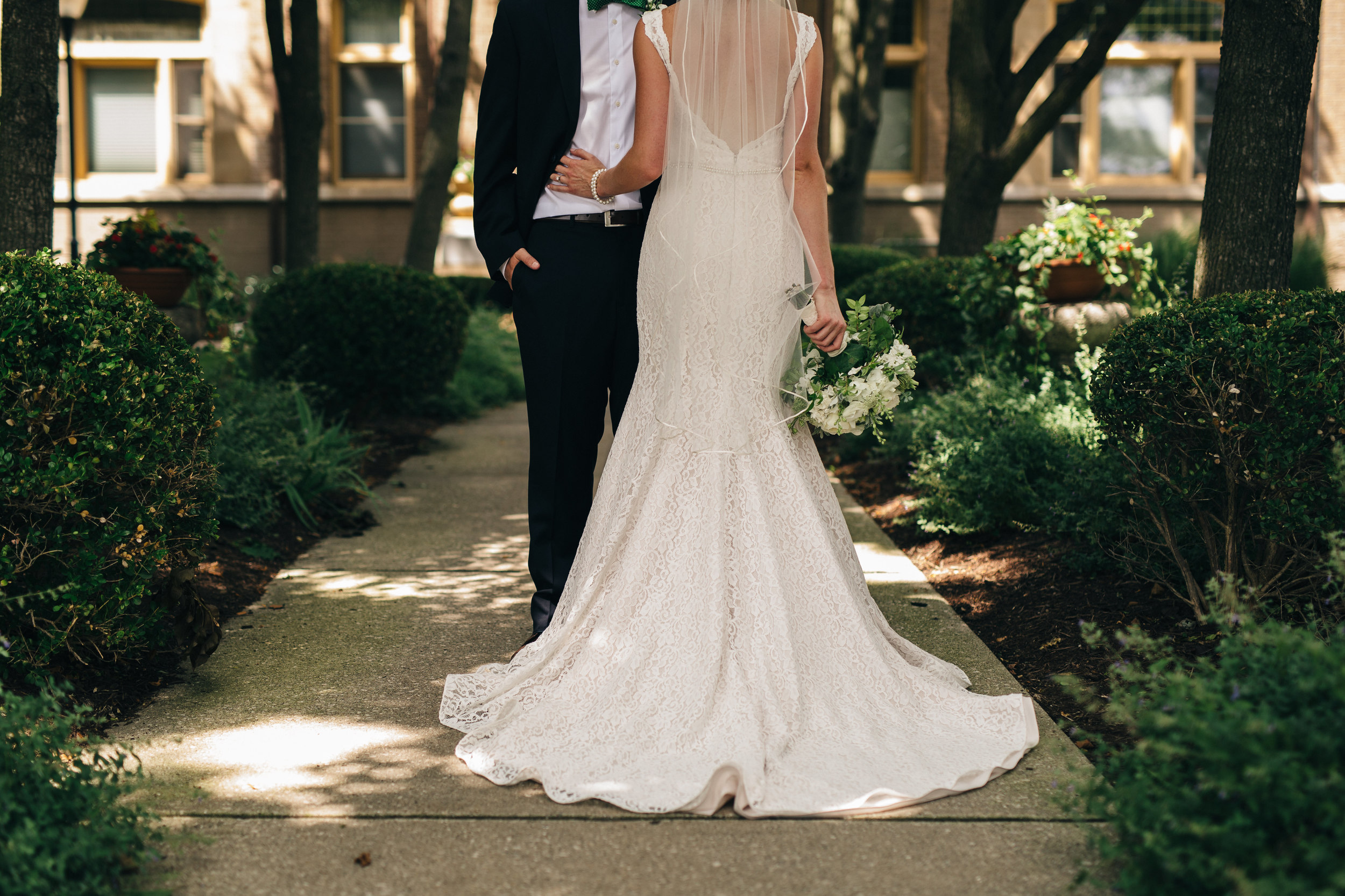 Bride in a lace Mikaella Bridal gown from Ivy Bridal in Columbus, Ohio.