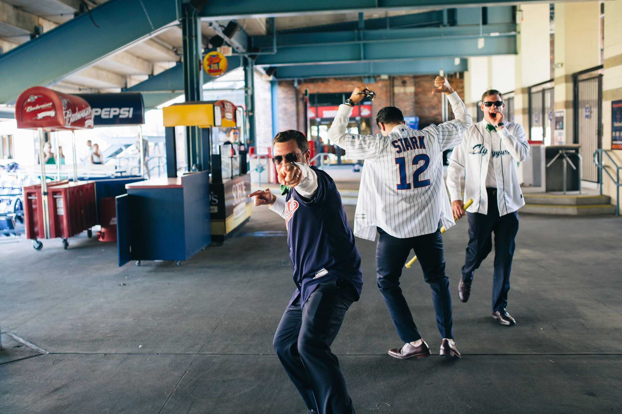 Groomsmen get baseball jerseys and take photos at Fifth Third Field.