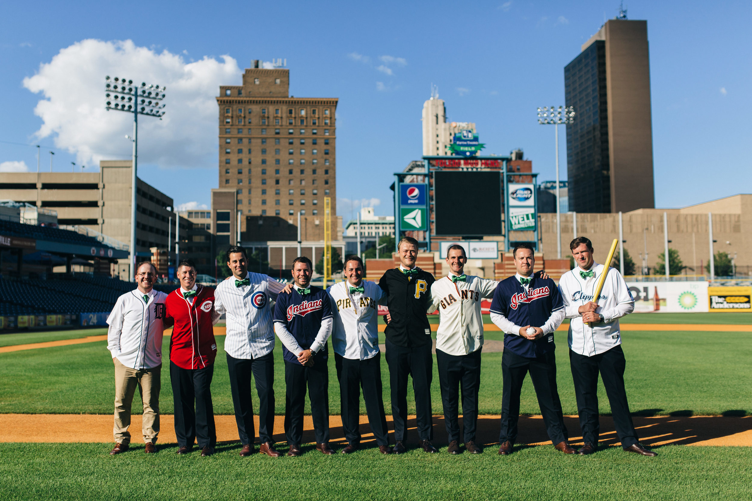 Groomsmen in custom baseball jerseys at Fifth Third Field in Toledo.