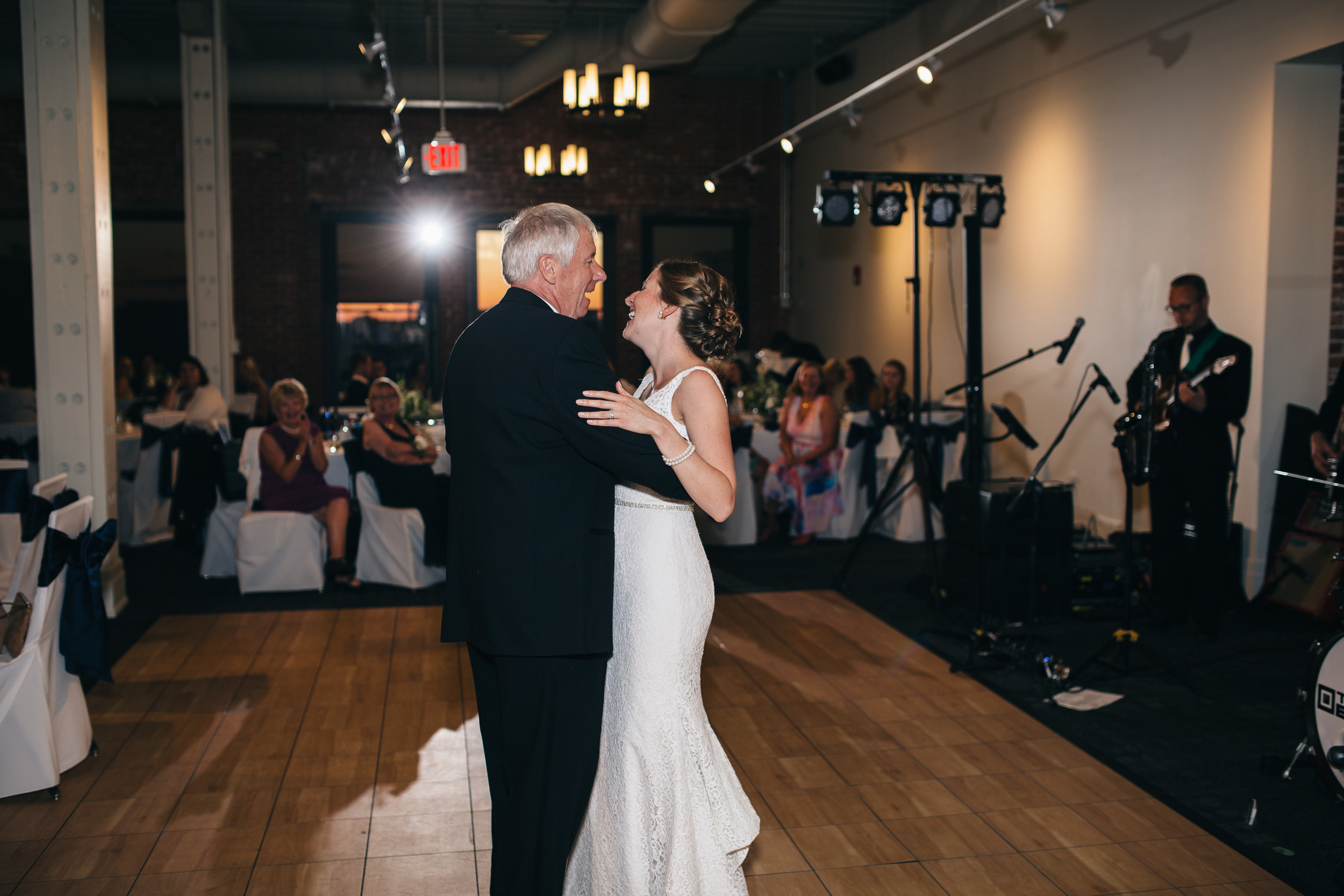 Bride dances with her father at downtown Toledo wedding reception.