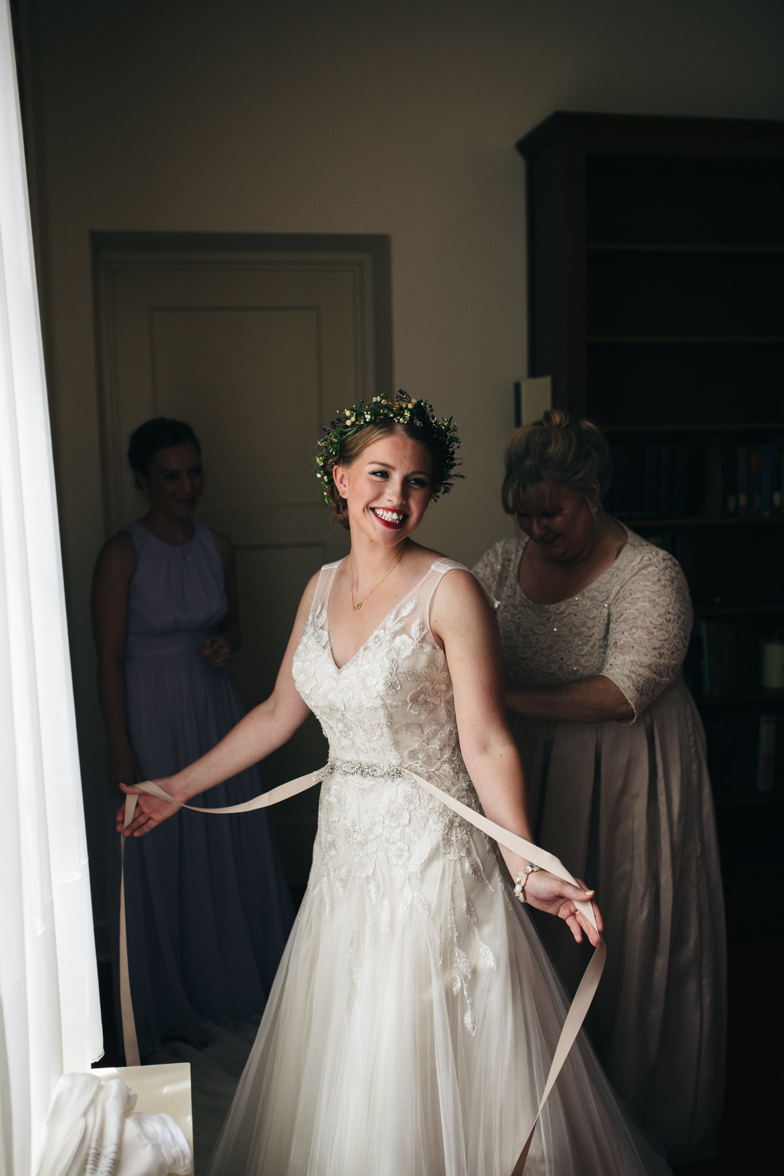 Bride in floral crow from La Boutique Nostalgie and gown from Belle Amour Bridal