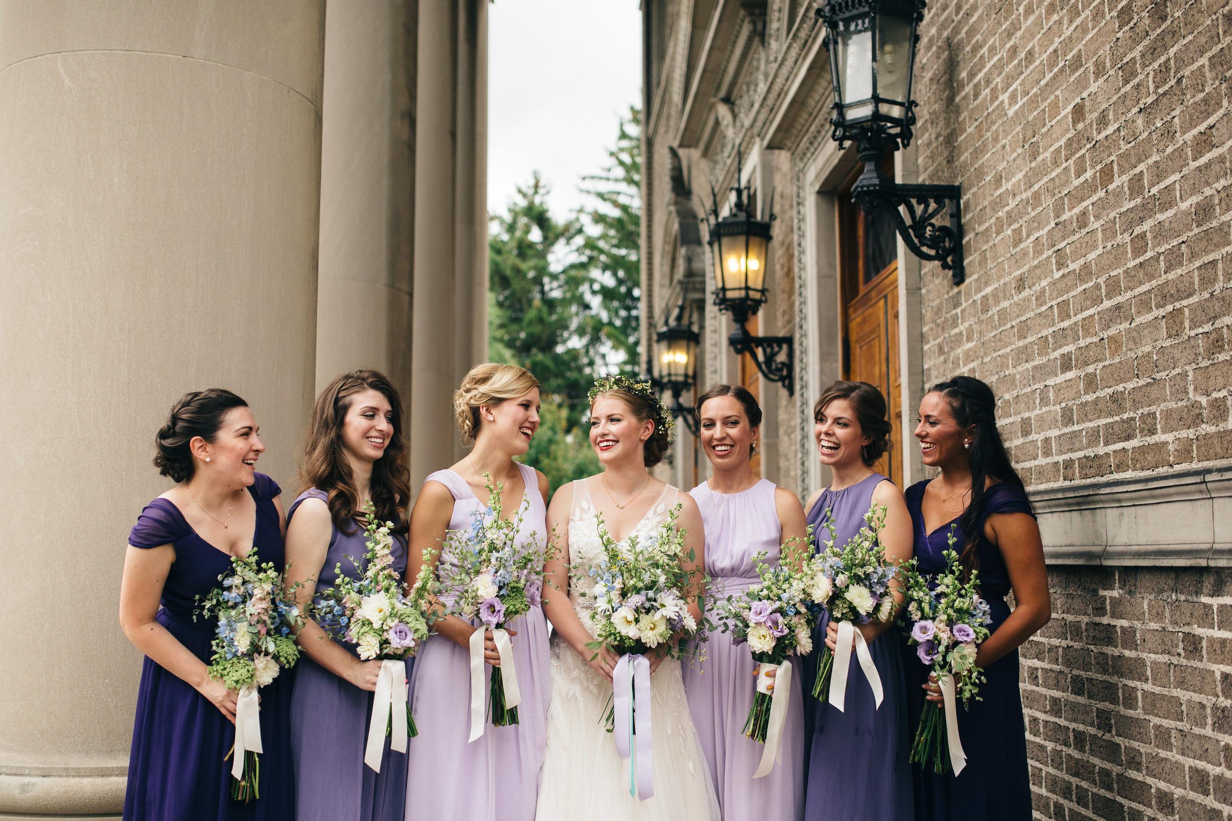 Bridesmaids in purple ombre dresses.