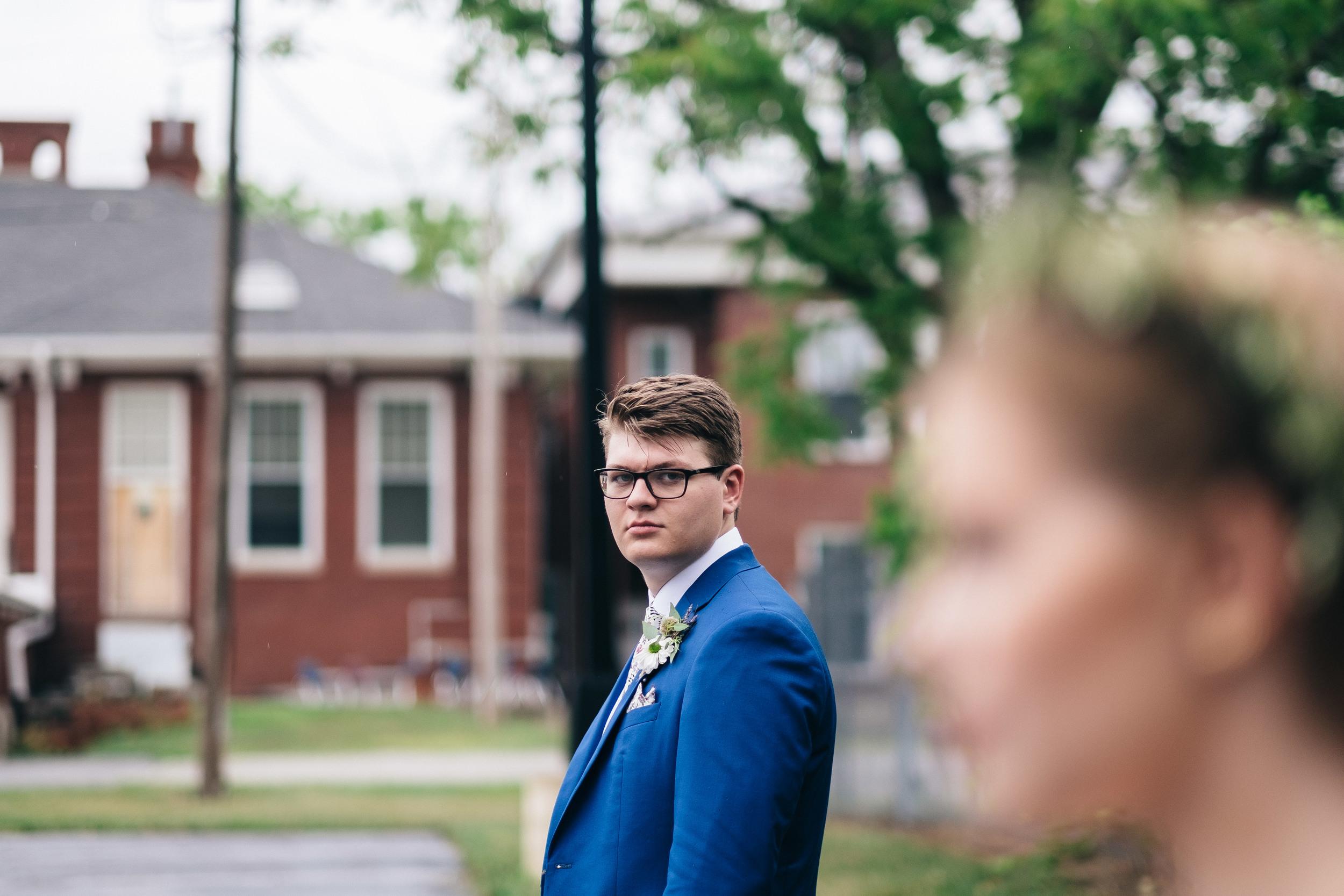 Groom in jet blue suit.