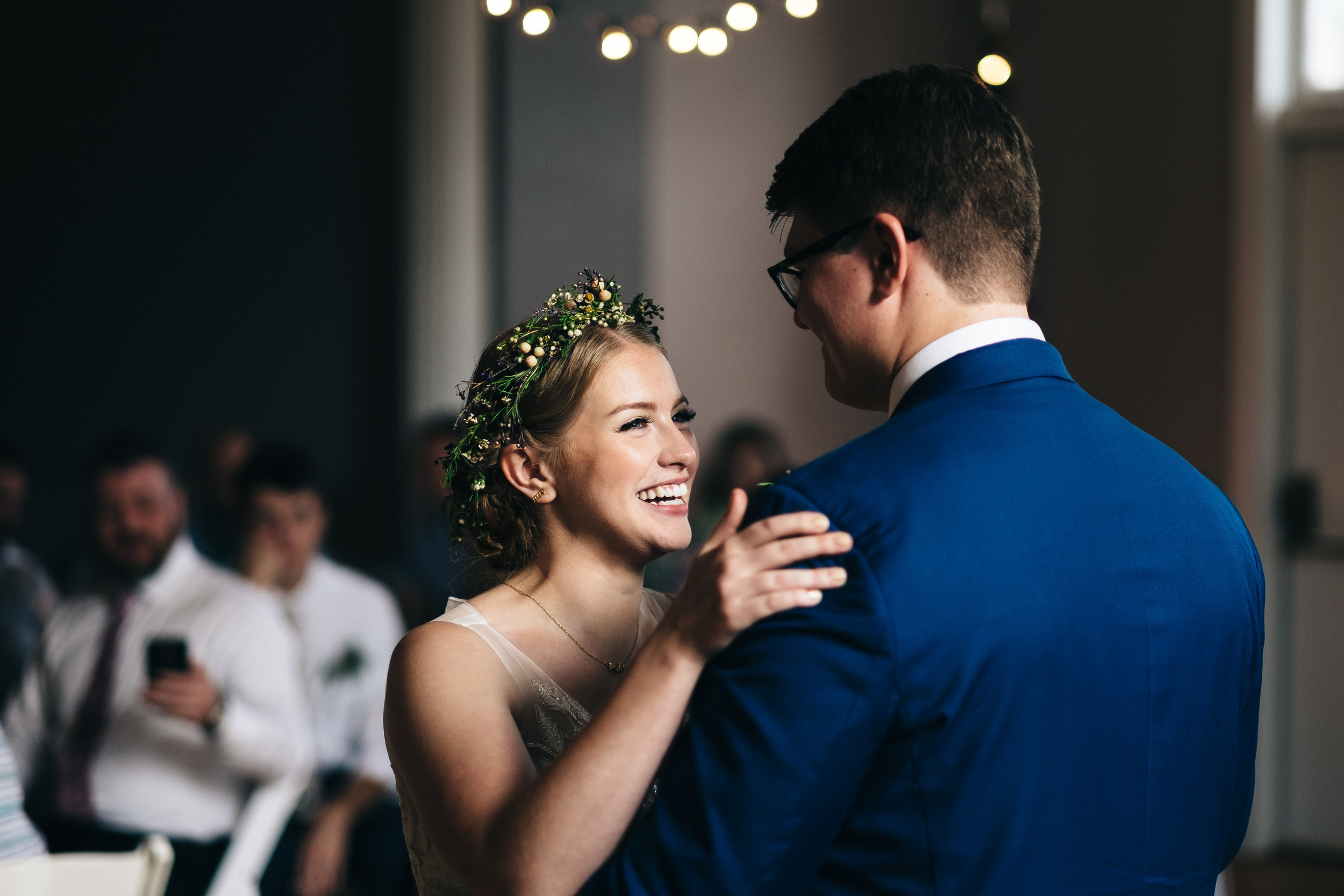 First dance between bride and groom at wedding reception.