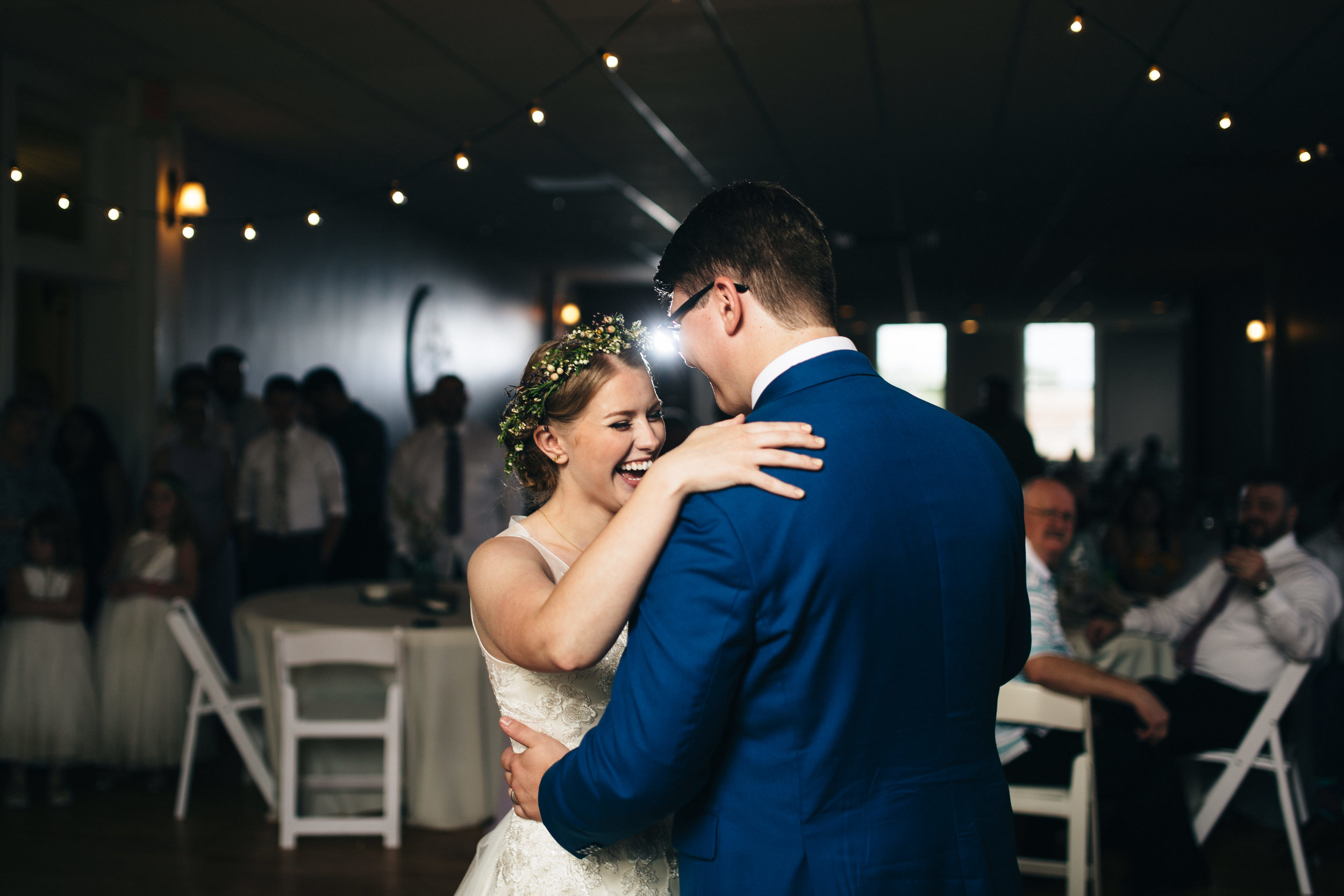 Bride and groom first dance at wedding reception.