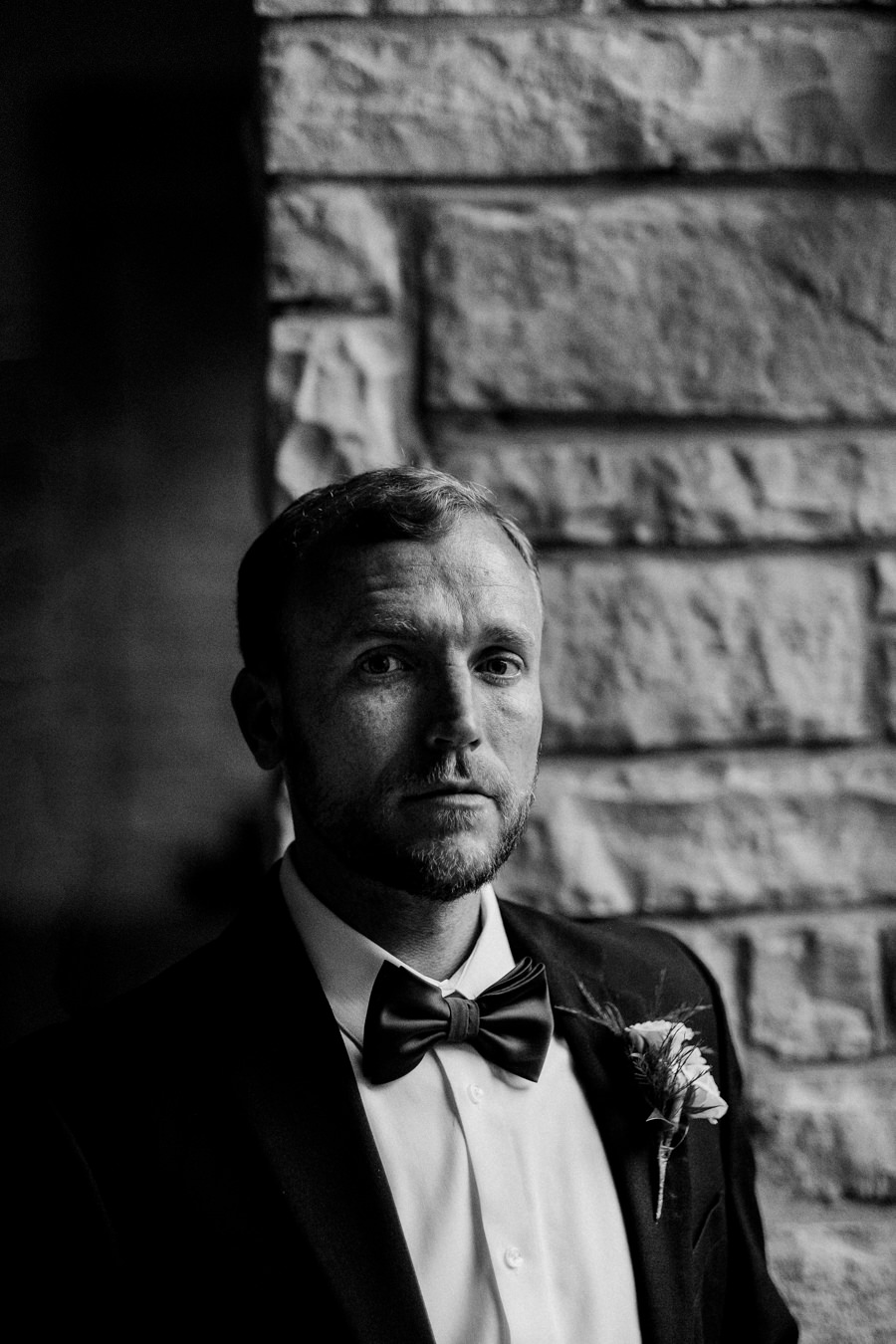 Black and white portrait of groom