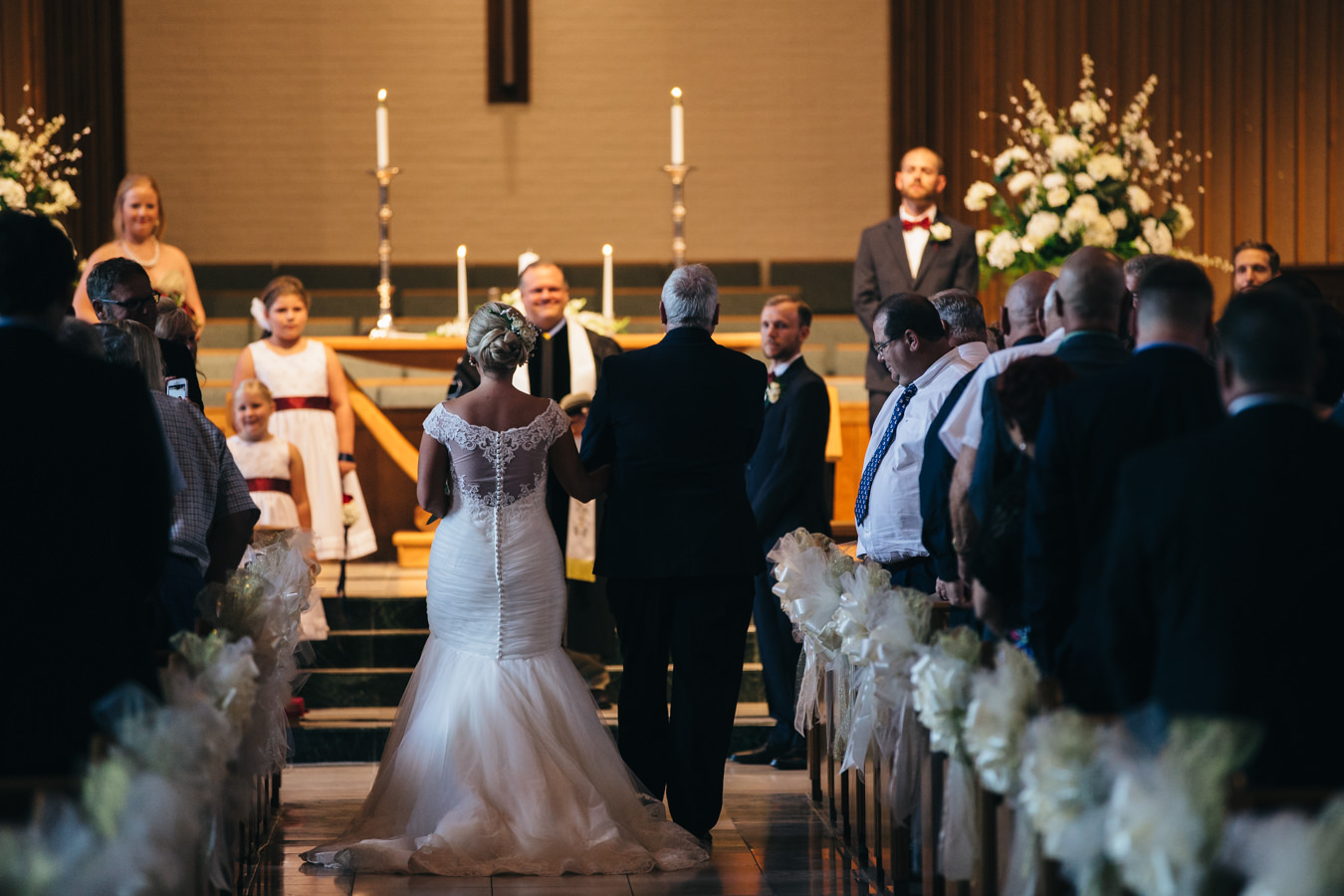 Brides father walks her down the aisle at Epworth United Methodist Church in Toledo