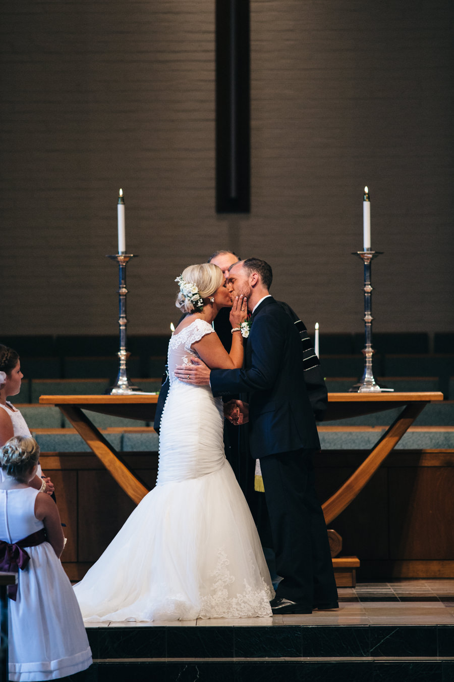 Bride and groom's first kiss at wedding ceremony.