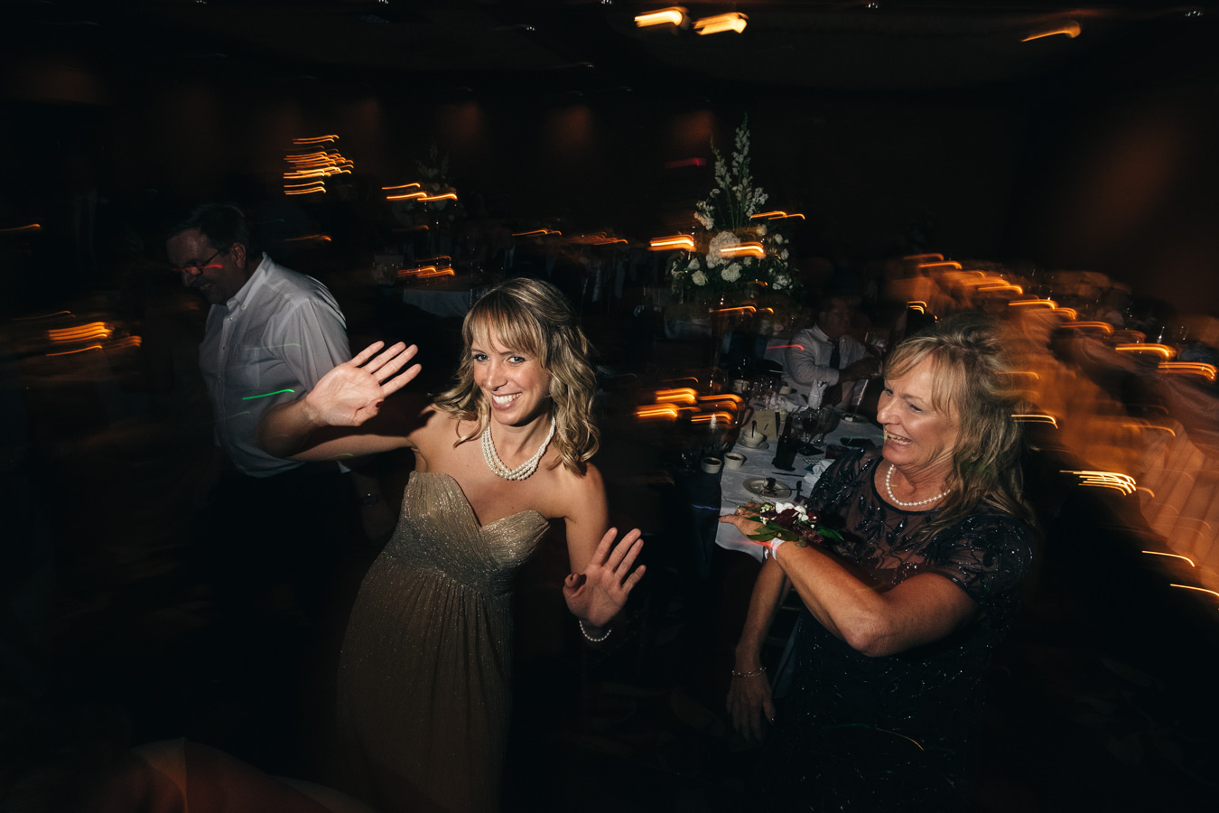 Guests dance at wedding reception at The Pinnacle in Maumee, Ohio.