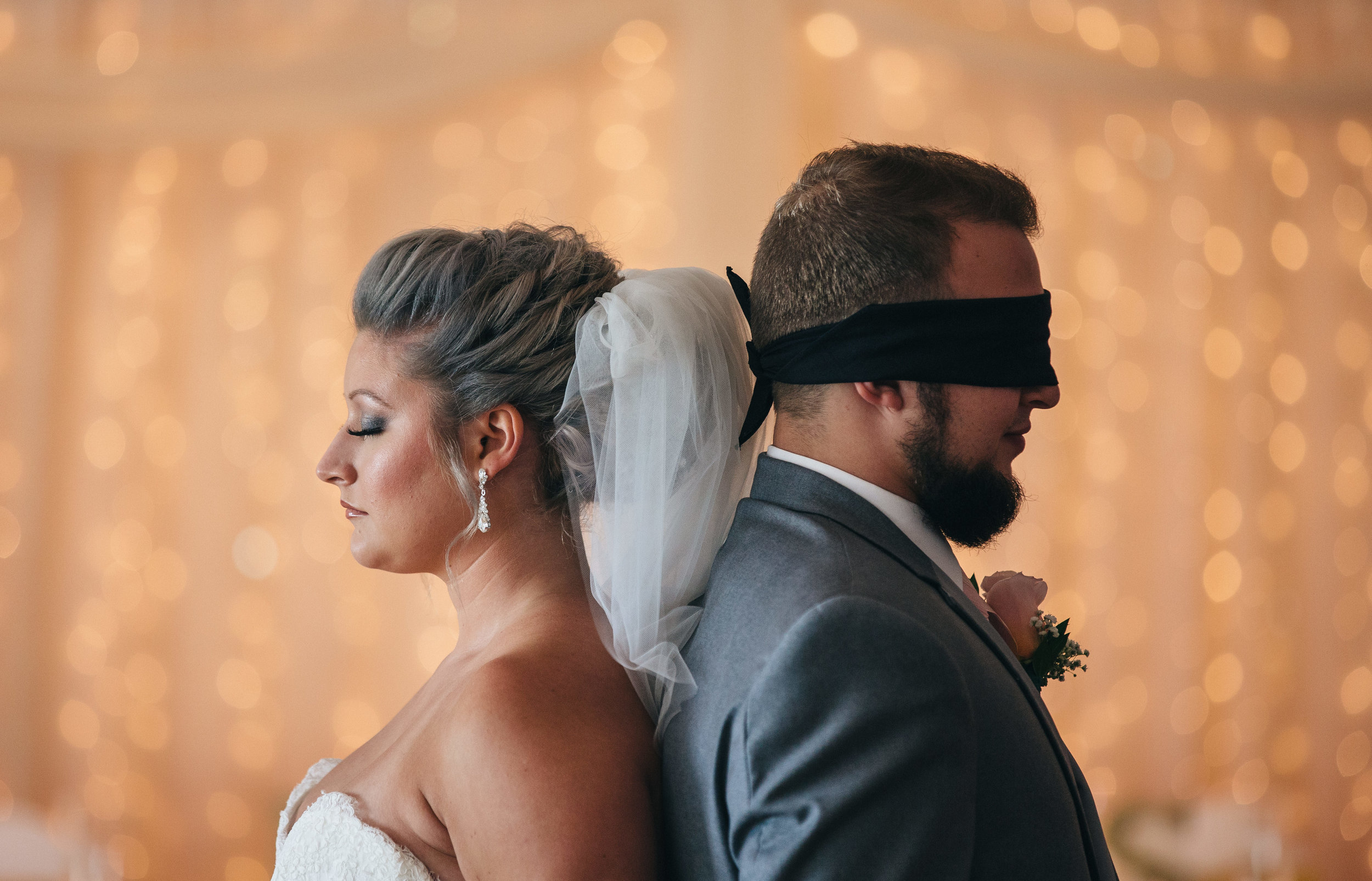Bride and groom do blind prayer on wedding day at Stone Ridge Golf Club.