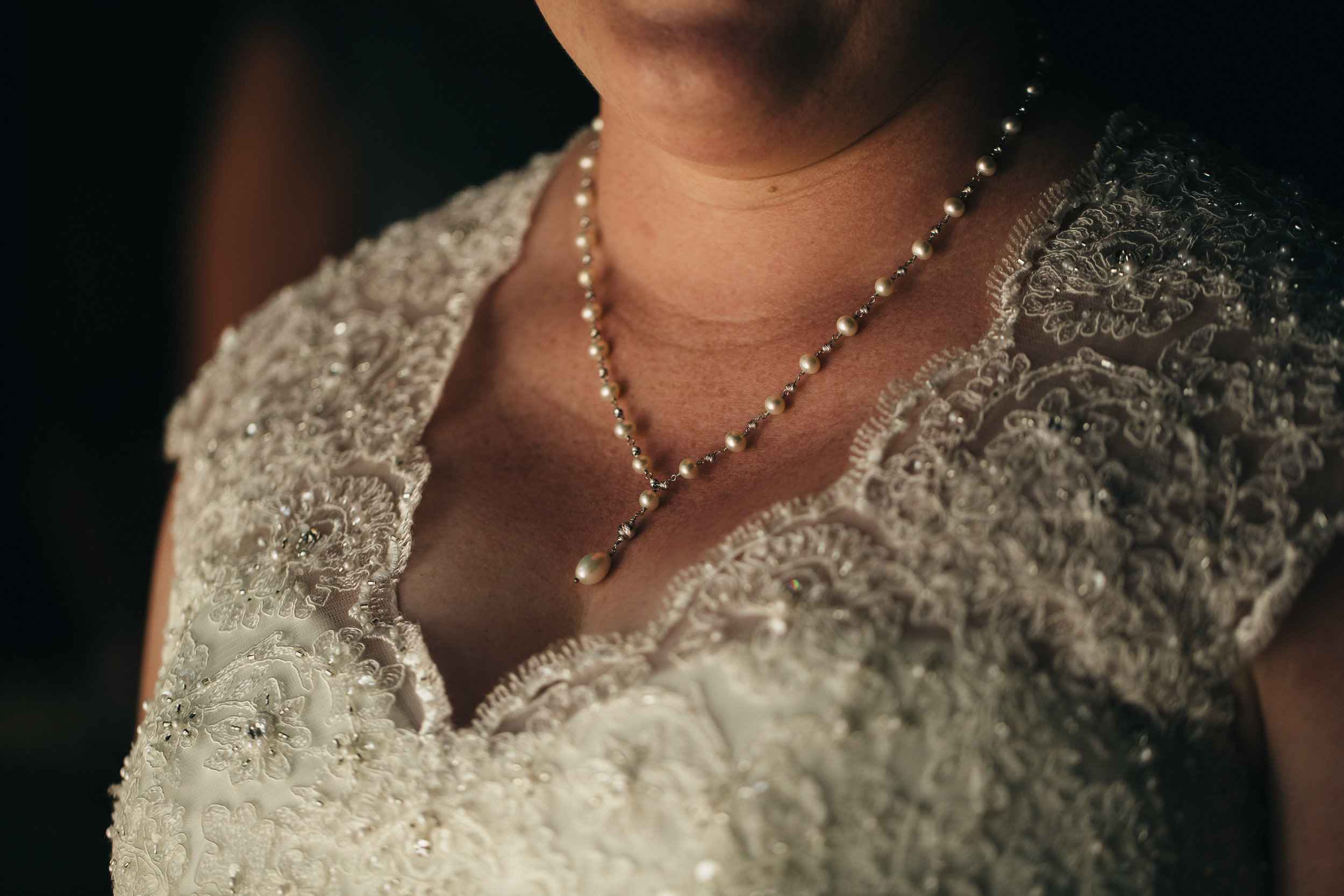 Elegant pearl necklace on bride at Walden Inn & Spa.