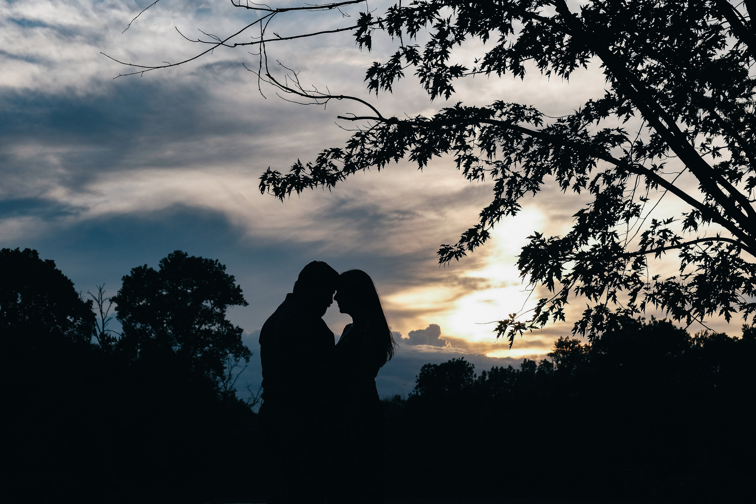 Silhouette photography at sunset engagement session.