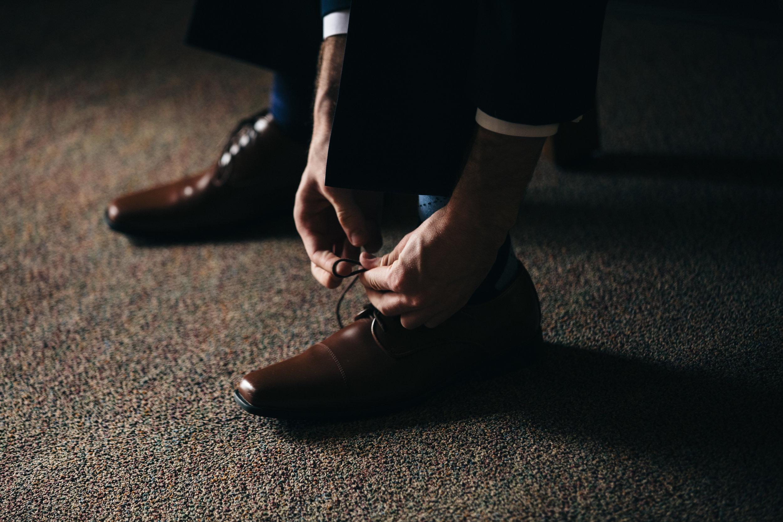 Wedding photography of groom's shoes.