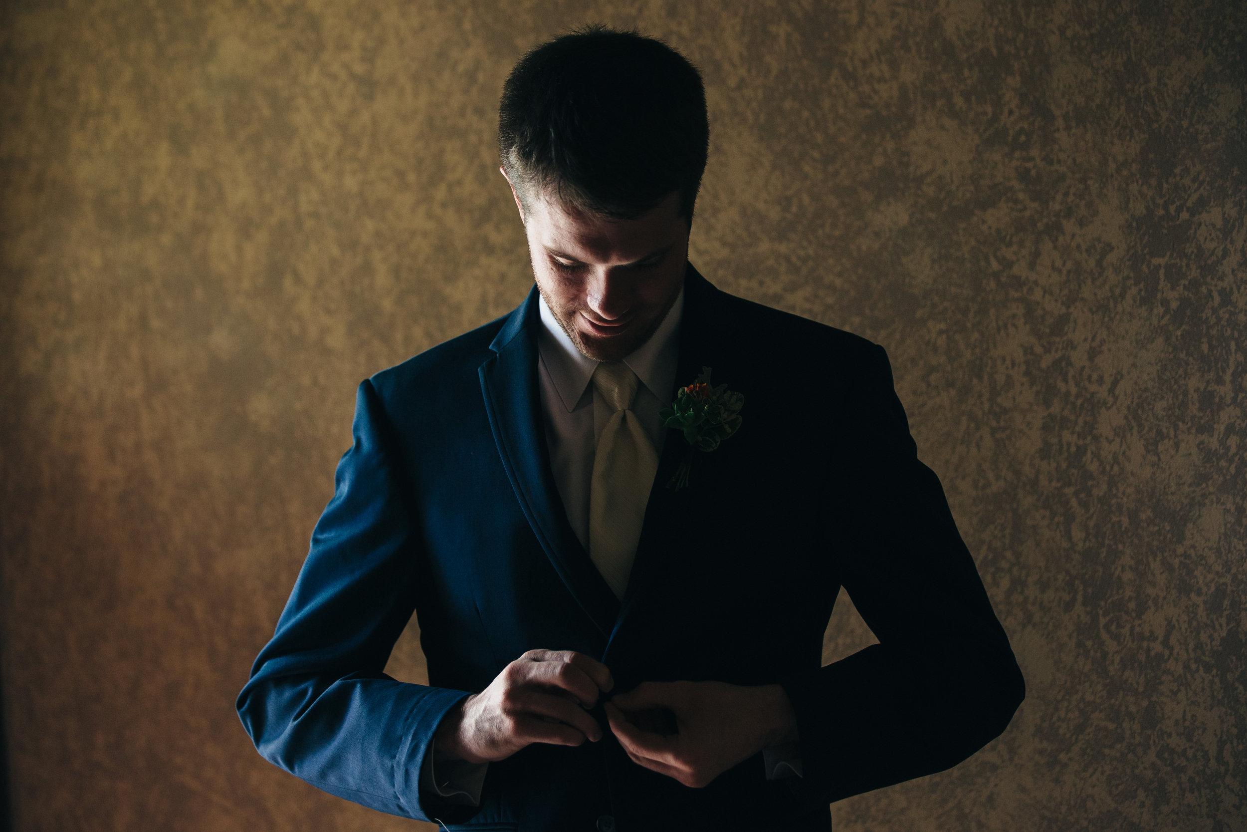 Groom getting ready for wedding day