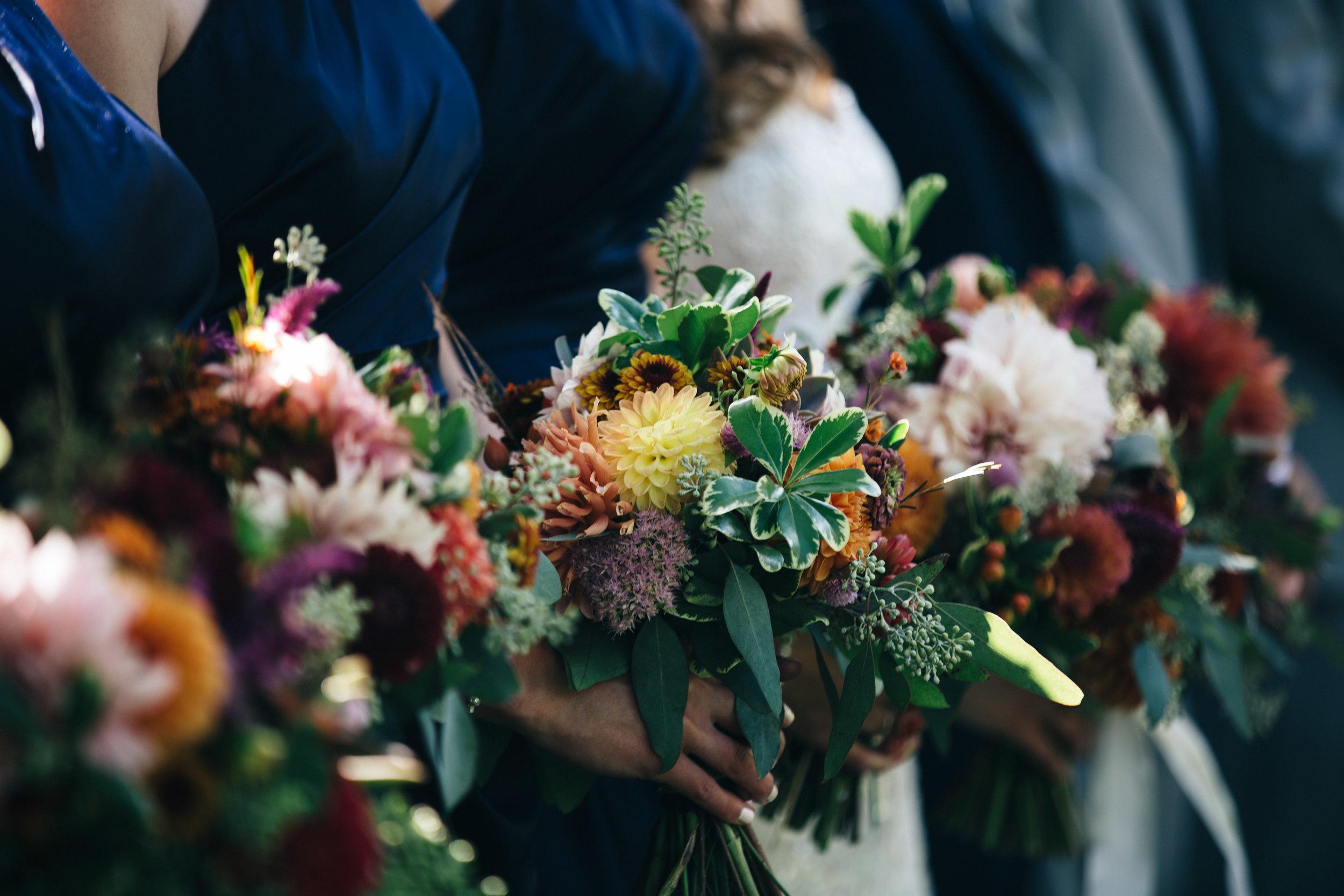 Lush floral arrangements for Fall wedding.