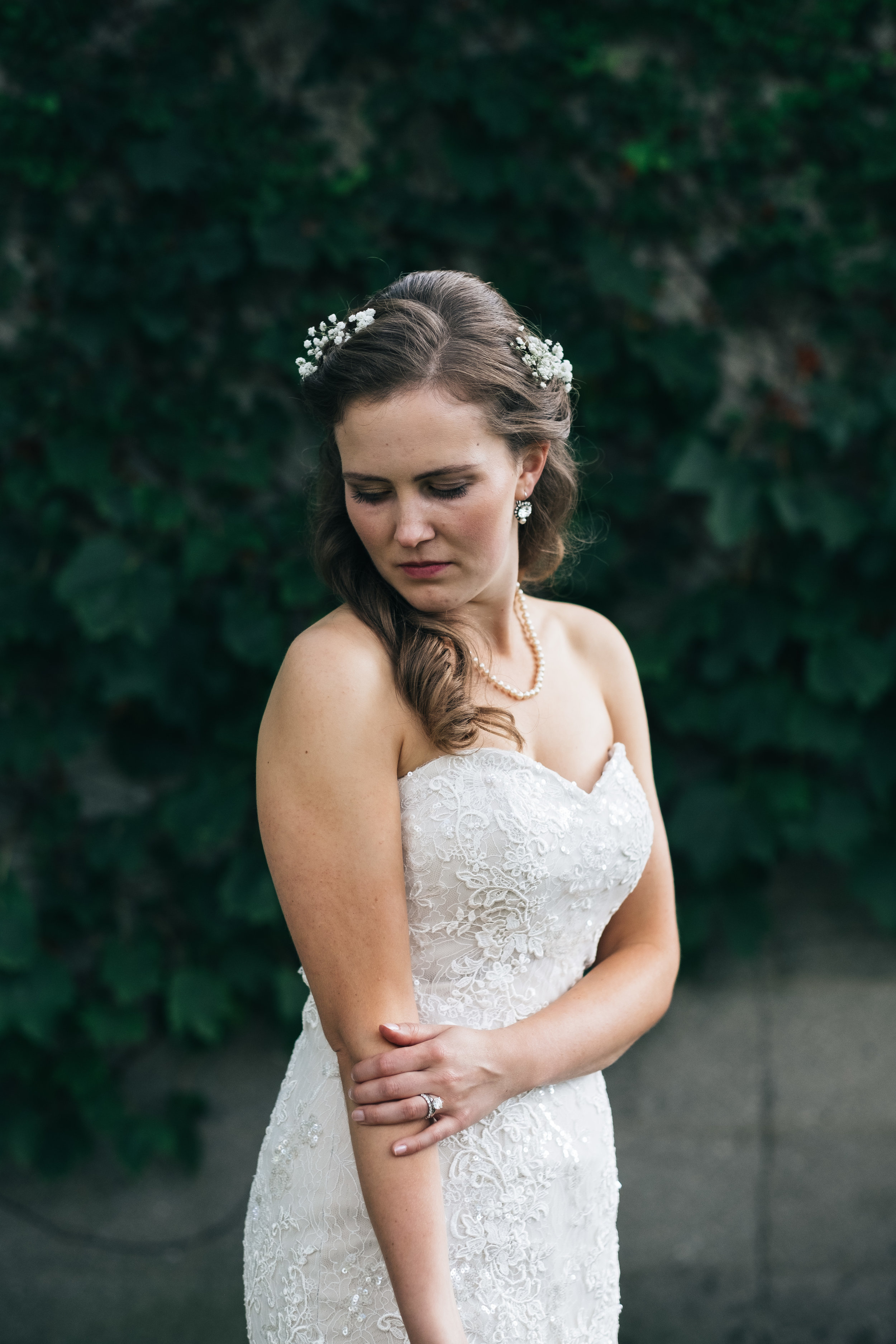 Wedding photography of bride in lace wedding dress.