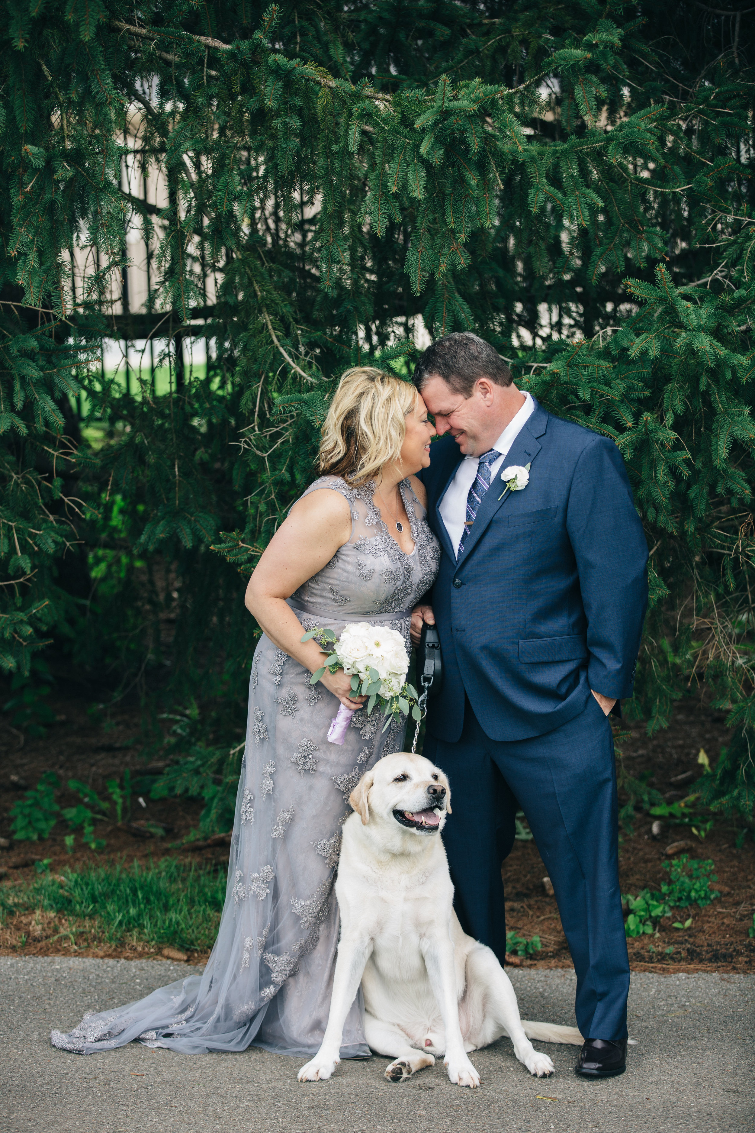 Bride and groom portraits with dog.