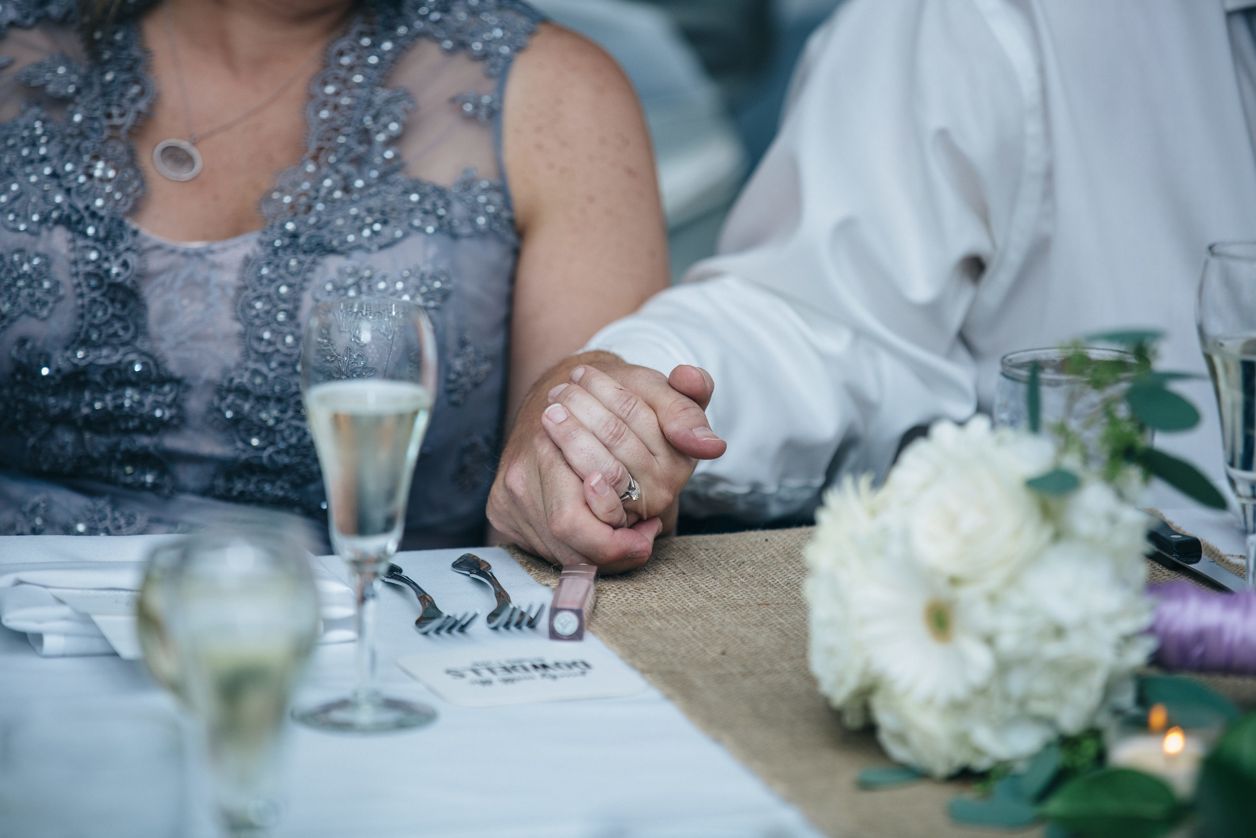 Purple lace reception dress on bride at wedding reception in Toledo, Ohio.