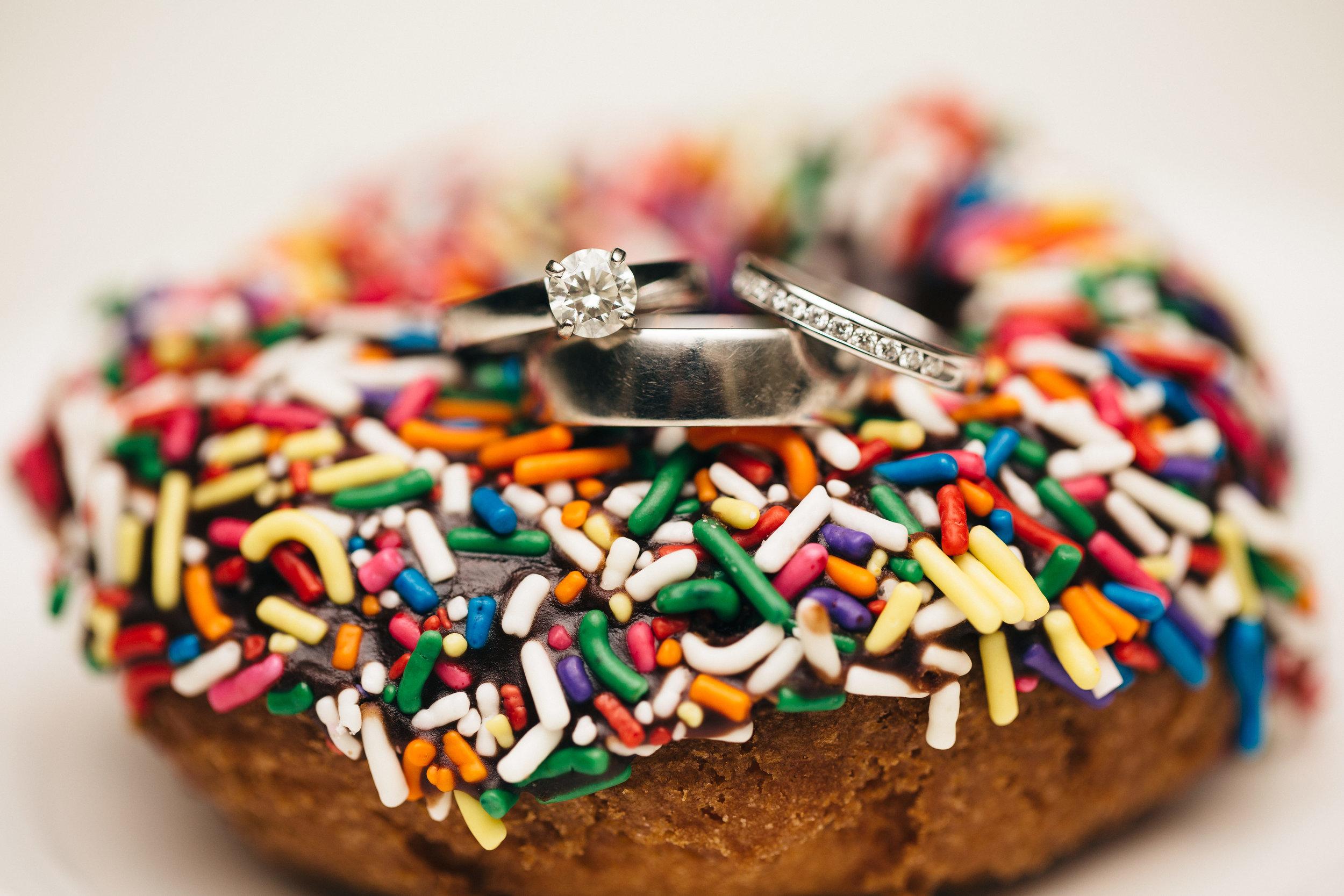 Wedding ring on a rainbow sprinkle doughnut at Highland Meadows in Toledo, Ohio.