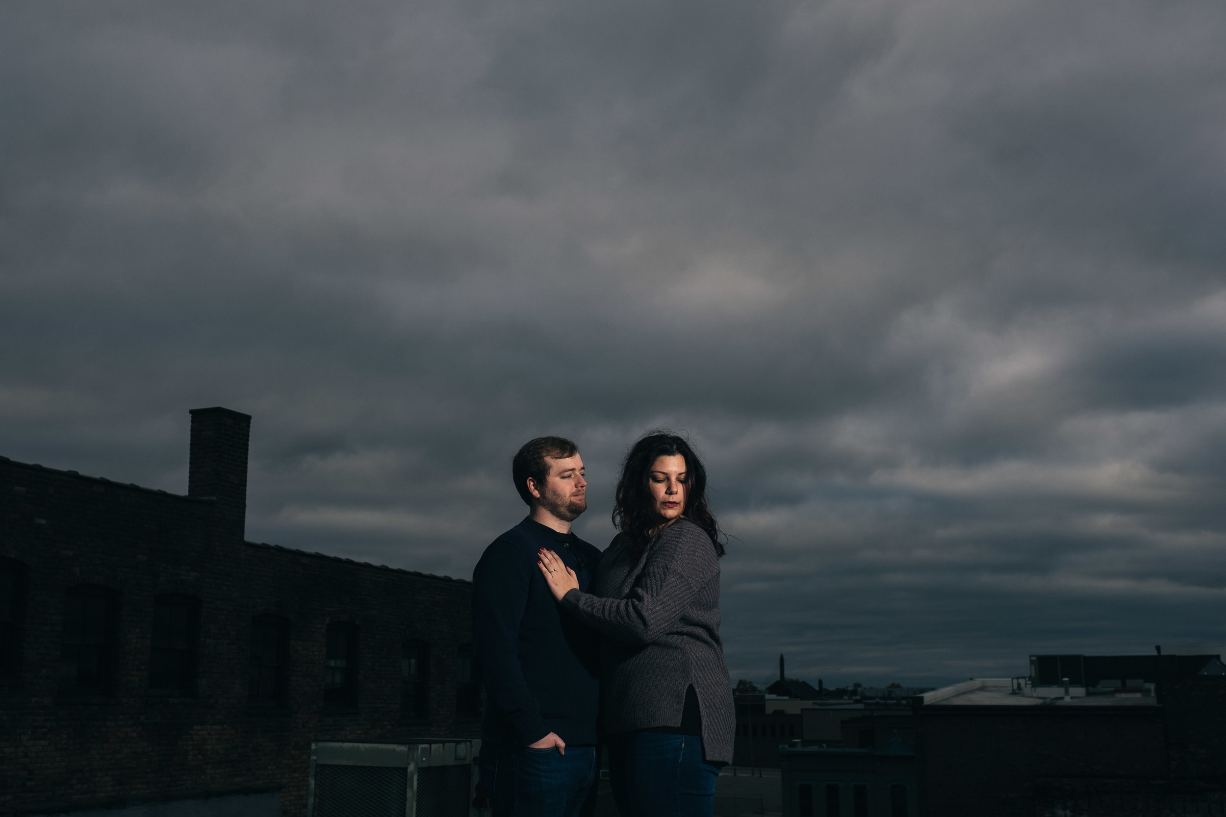 Downtown Toledo rooftop engagement picture.