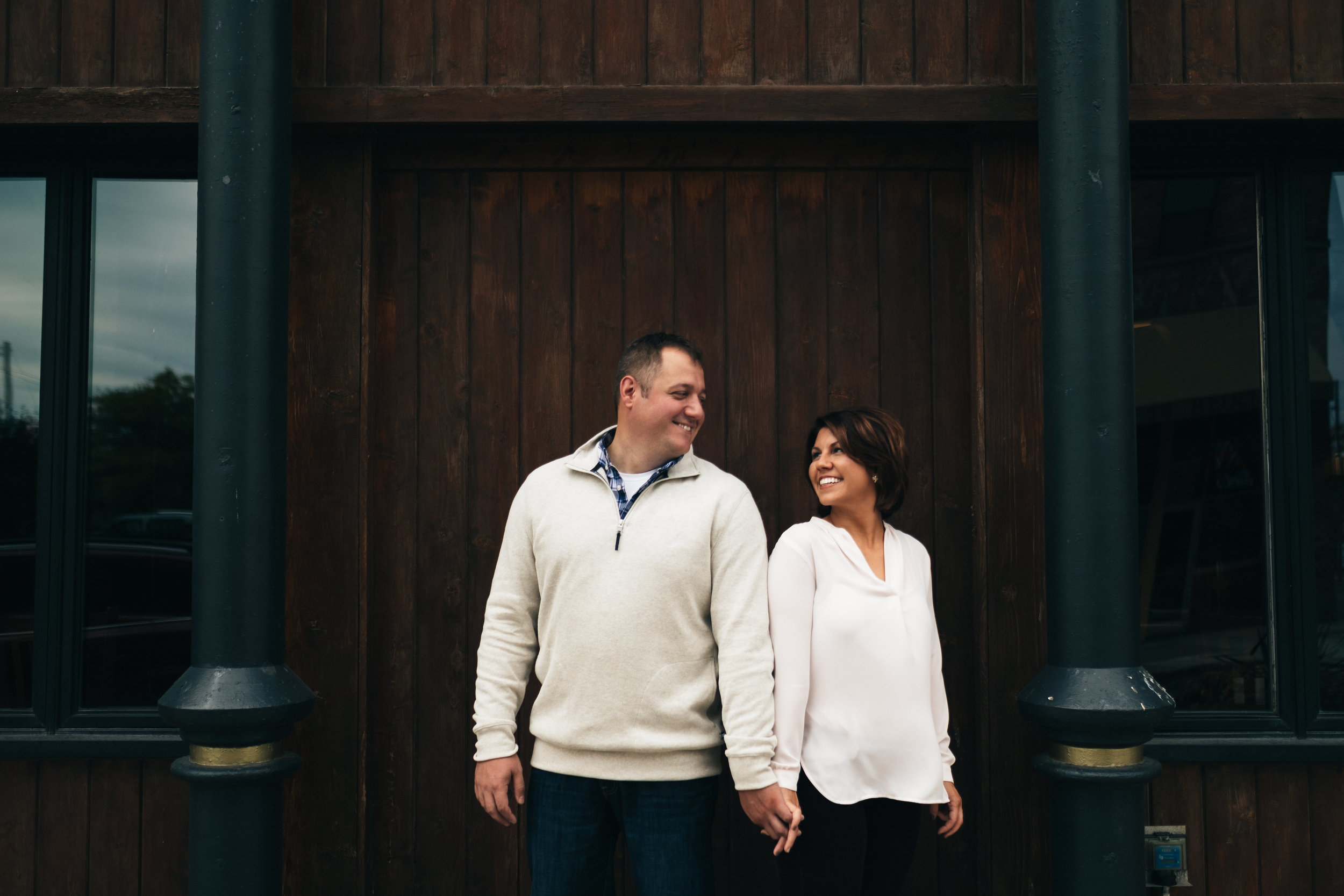 Outside fall engagement picture in downtown Toledo.