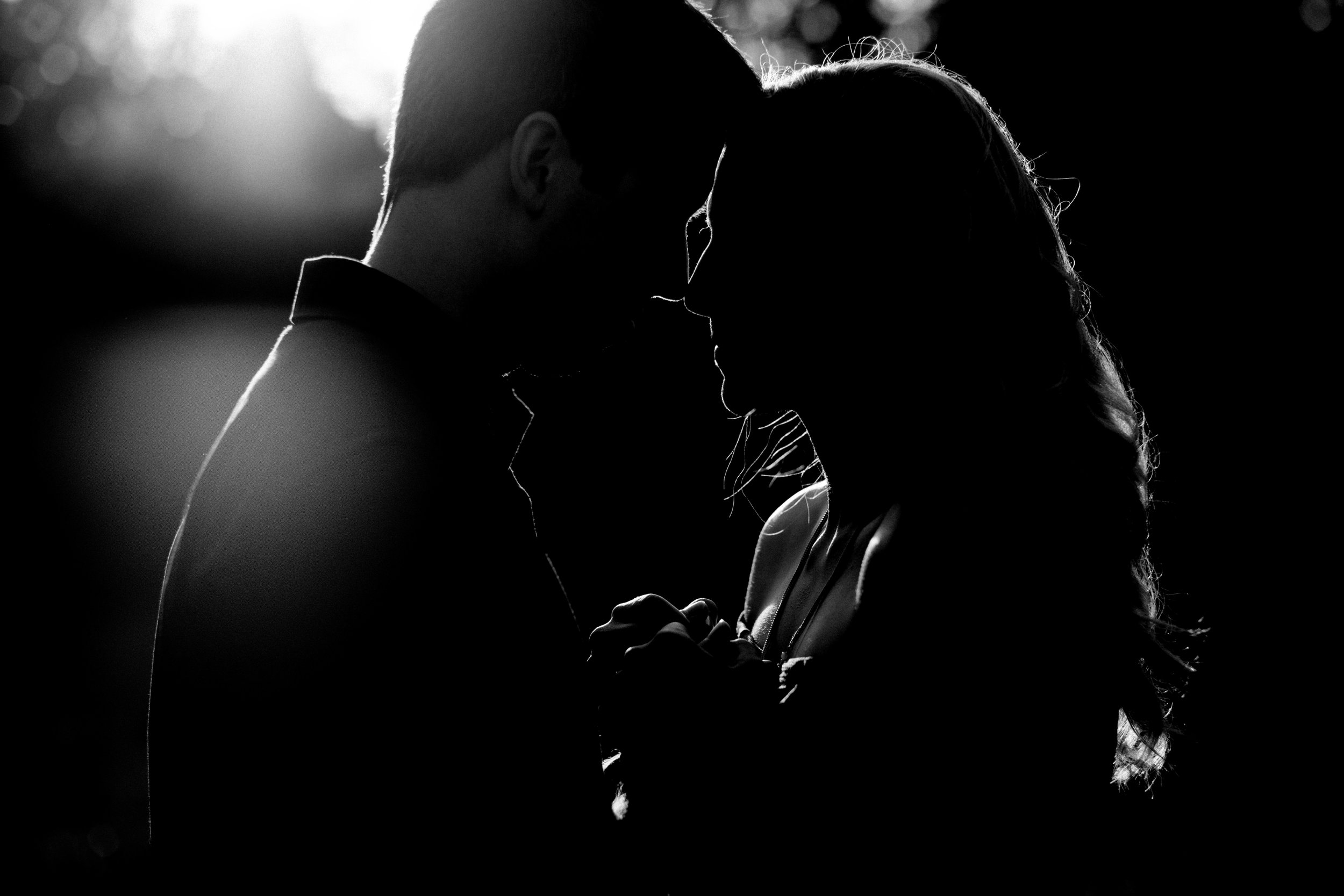 Black and white photography of engagement session at sunset.