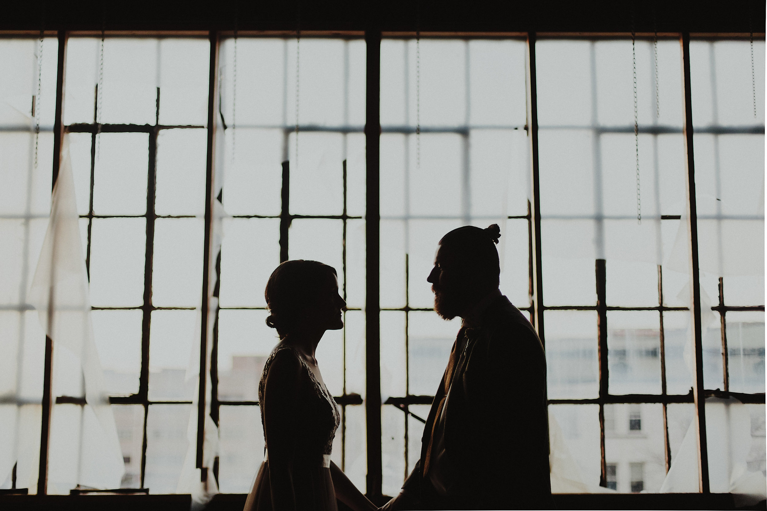 Bride and groom in downtown warehouse wedding.
