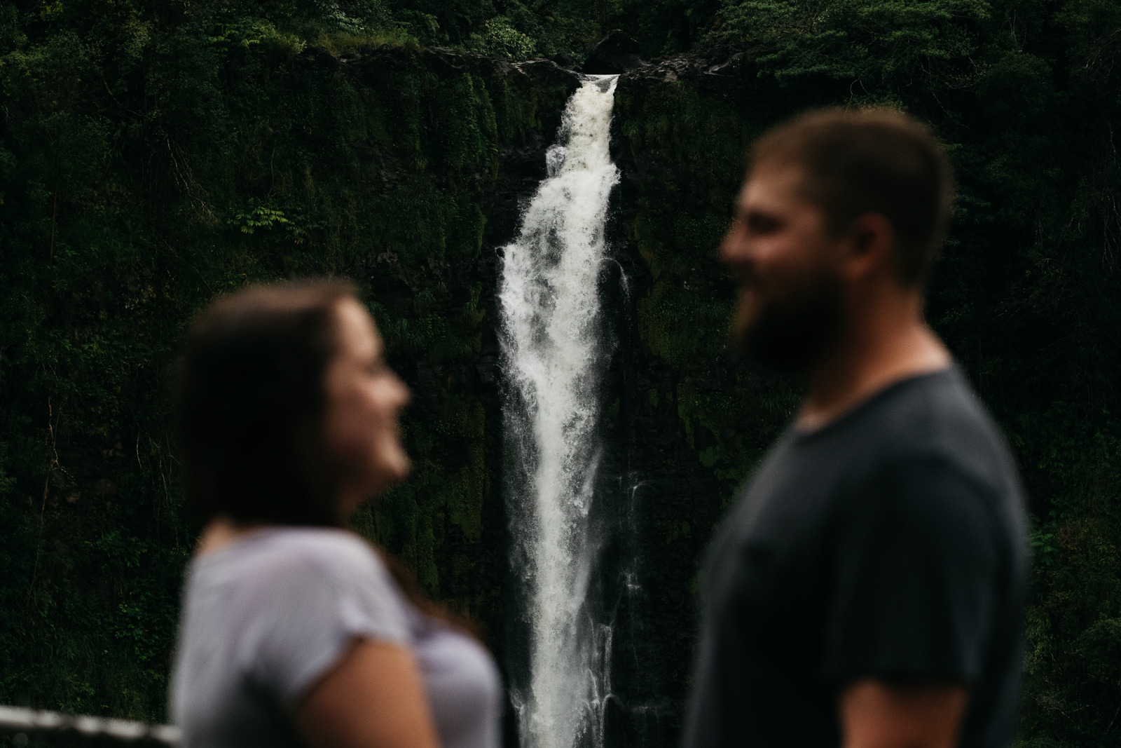 Engagement photography in Hawaii near a waterfall.