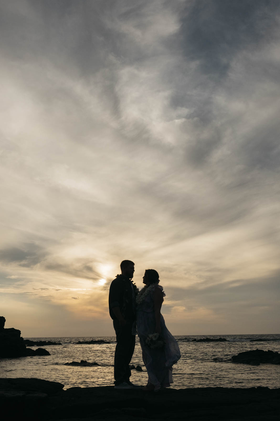 Silhouette of the bride and groom in Kona, Hawaii.