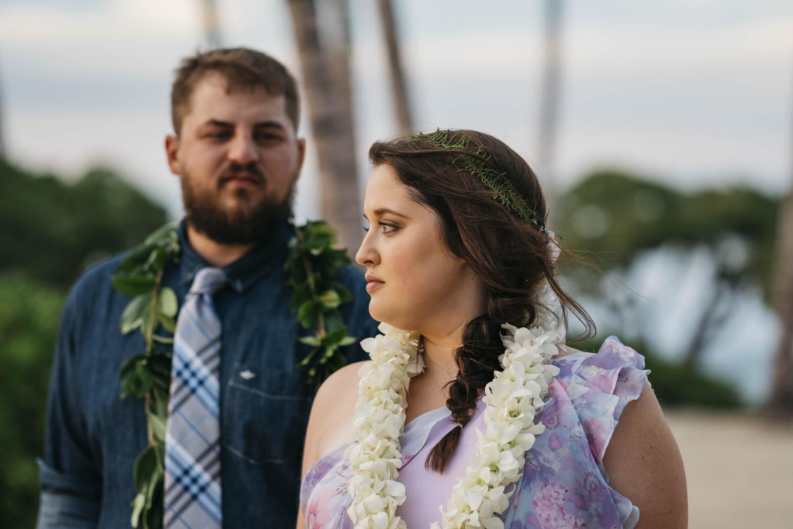 Hawaiian bride and groom portrait walking on the beaches on Kona, Hawaii.