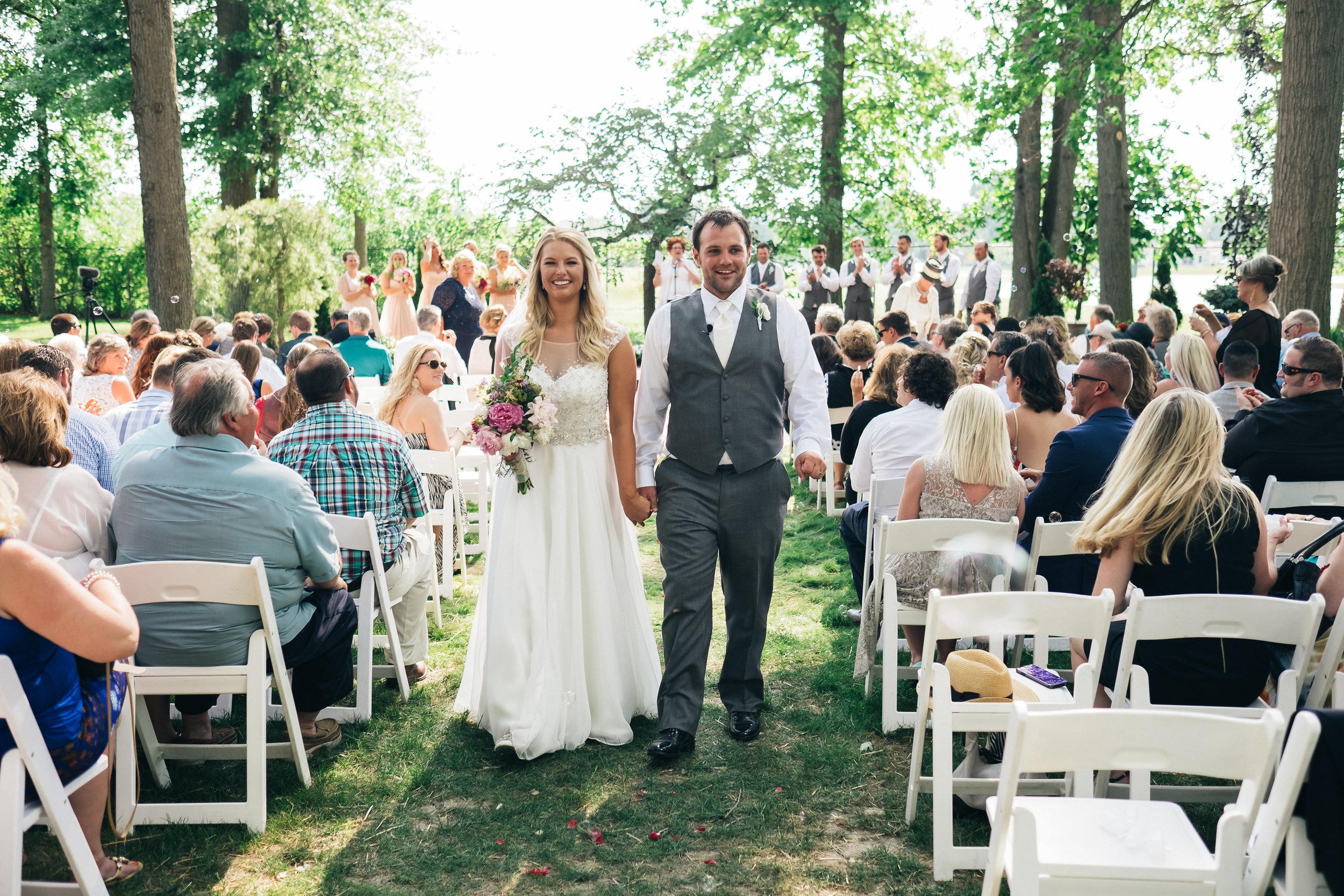 Danielle and Jake out in a garden wedding ceremony.