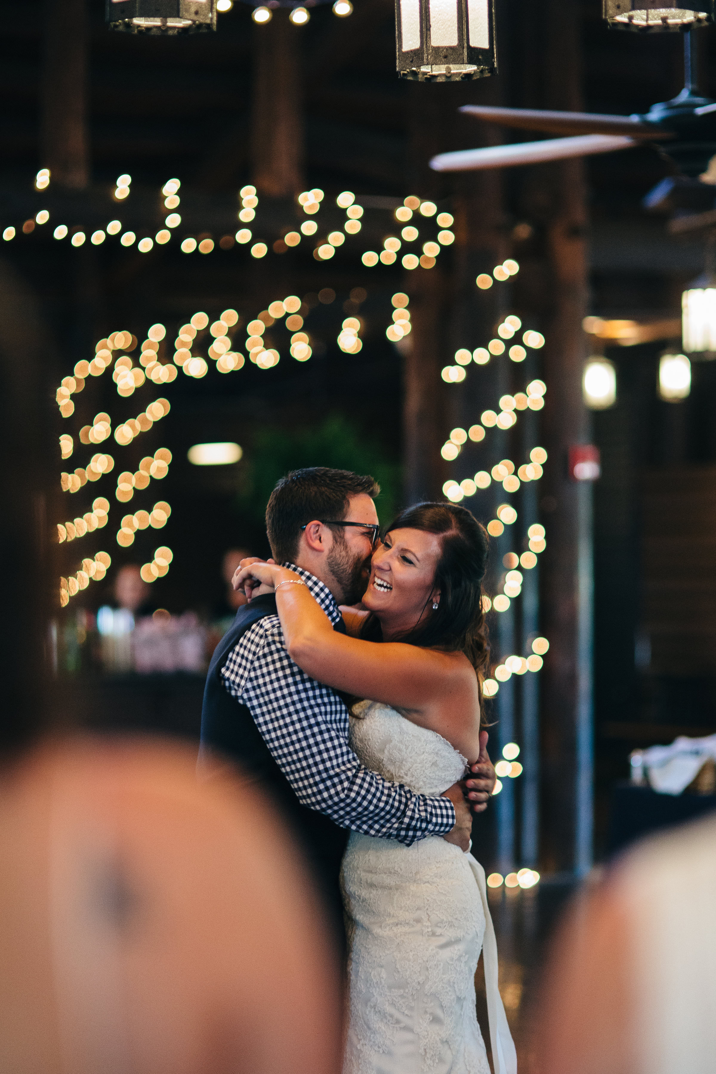 Bride and groom dancing at reception.