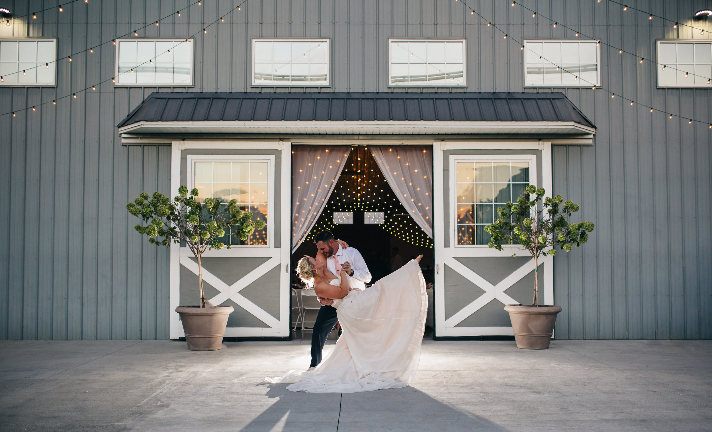 Bride and groom portrait at sunset at The Stables.