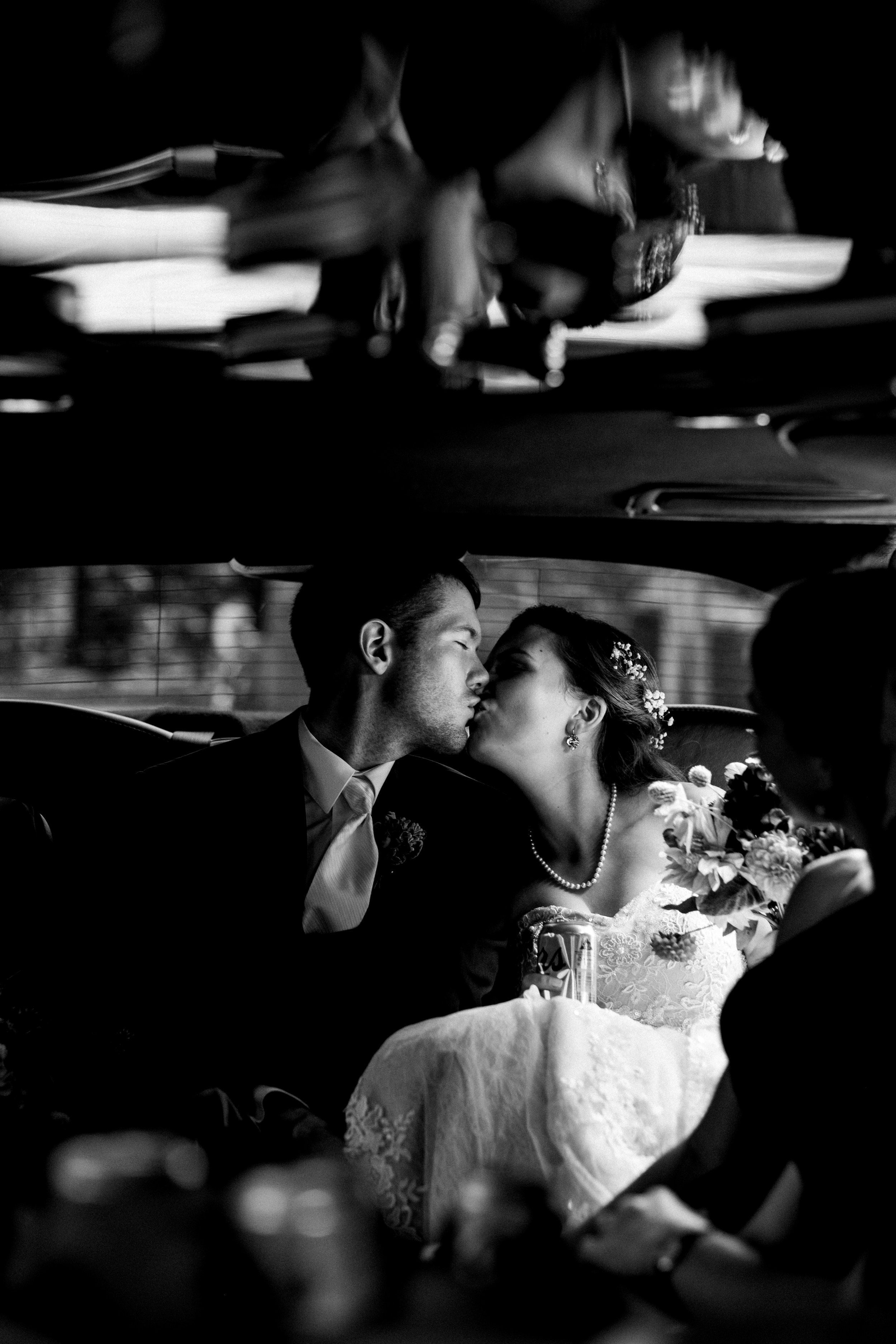 Bride and groom in limo ride on wedding day in Bowling Green, Ohio.