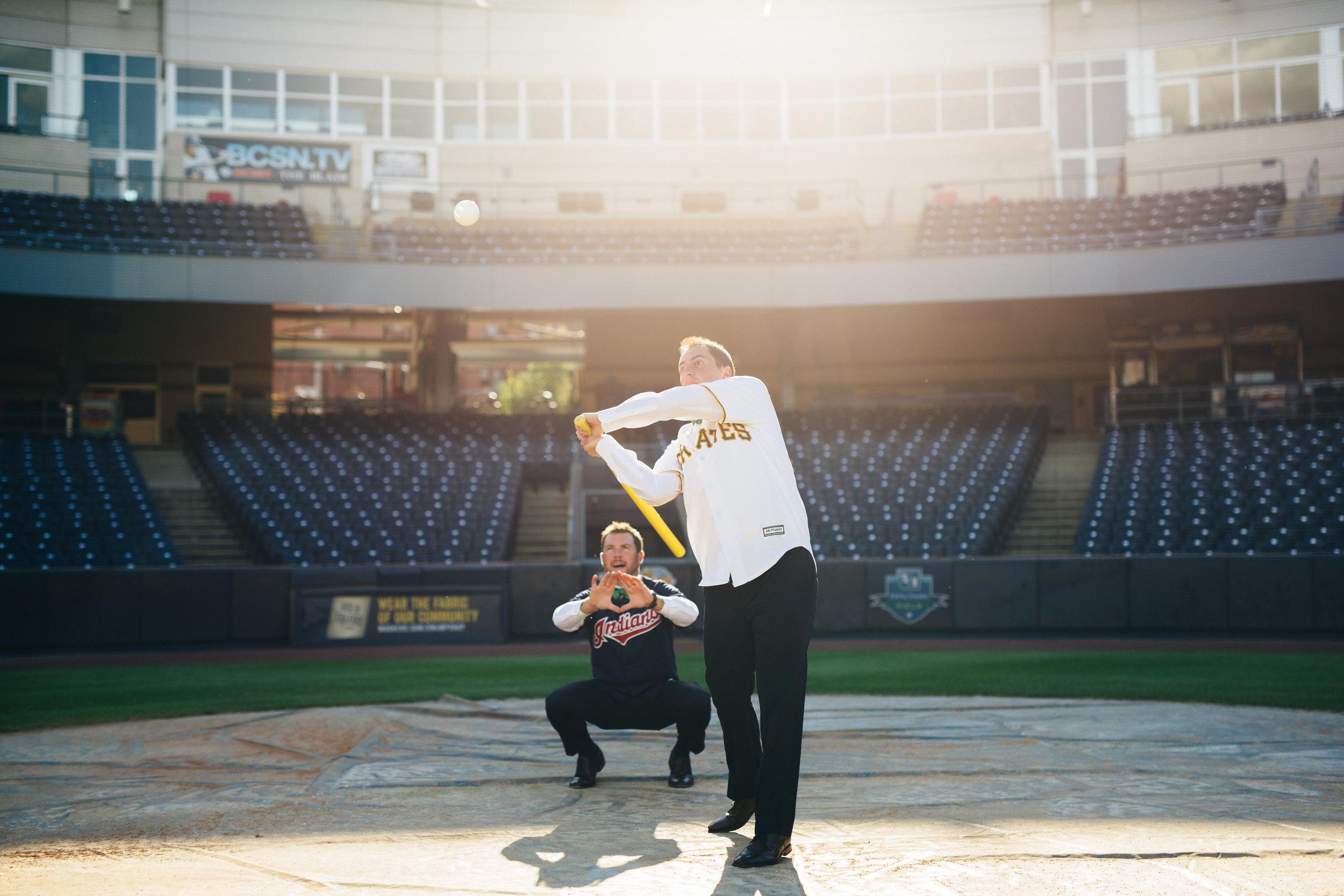 Fun baseball themed wedding photography at the Mudhen's Stadium in Toledo, Ohio.
