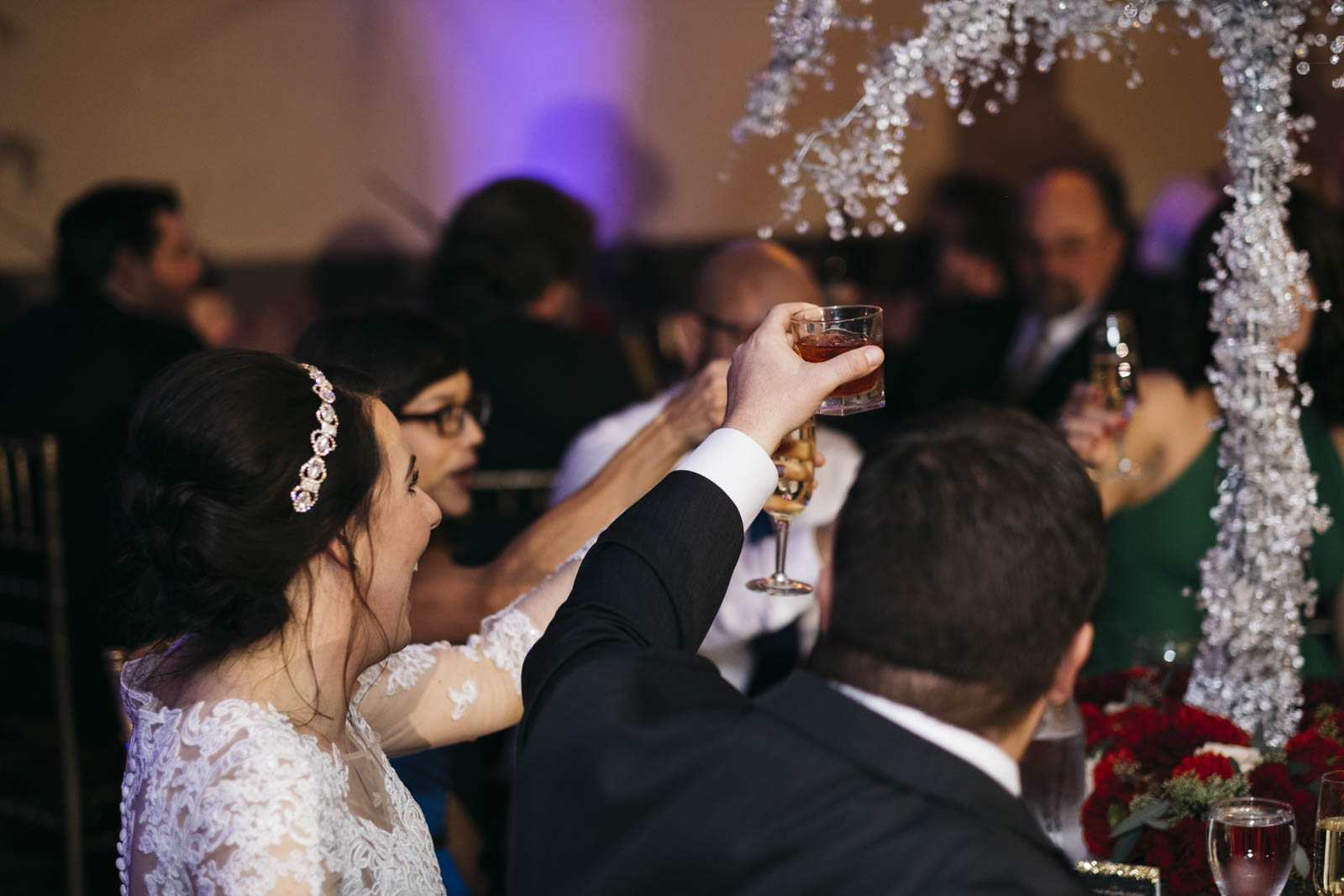 Bride and groom toast at wedding reception.
