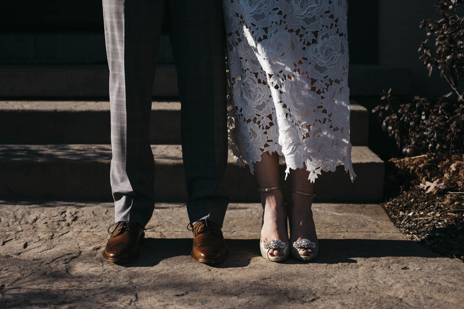 Bride and groom's shoes on their wedding day.
