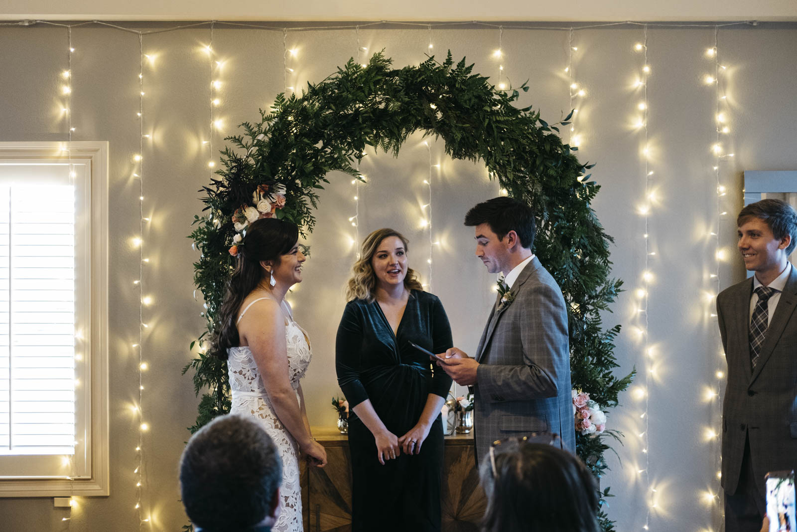 Groom reading vows at in-home ceremony on New Year's Day.