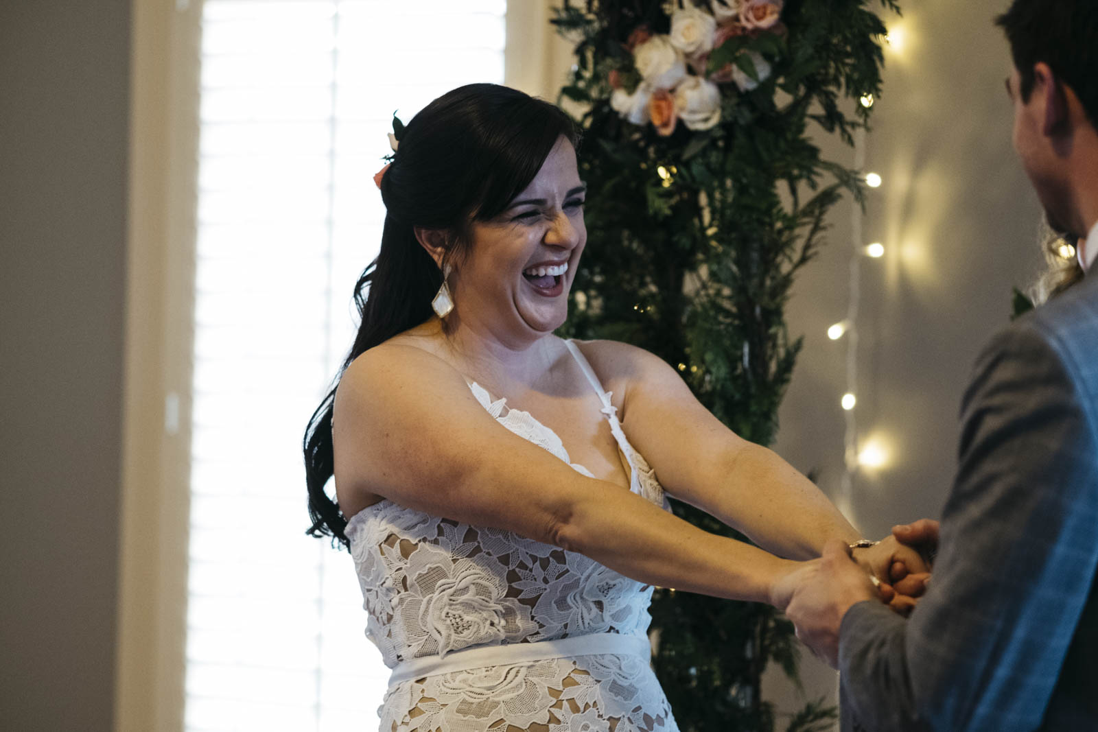 Bride laughing during her wedding ceremony.