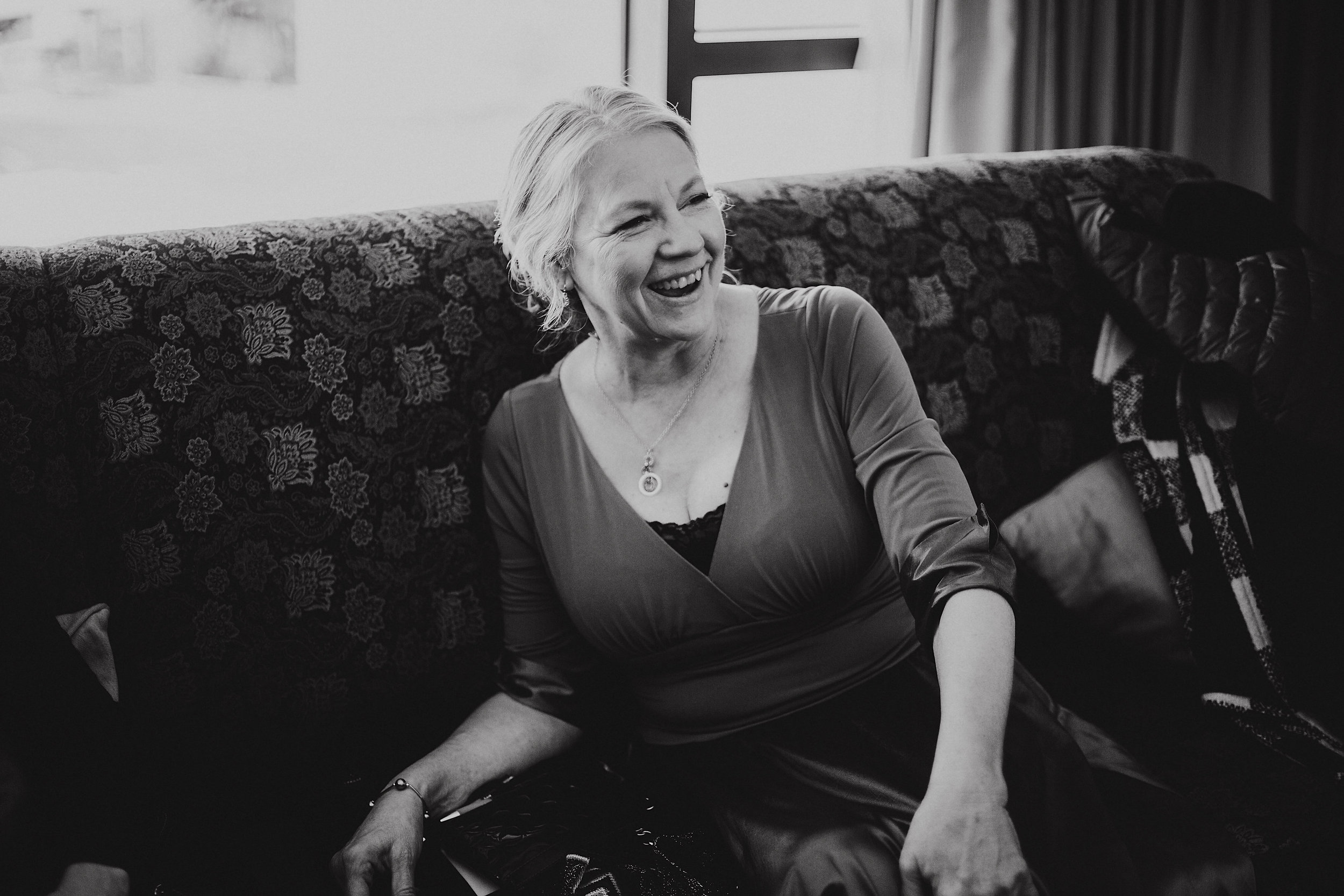 Woman laughing in wedding day photo.