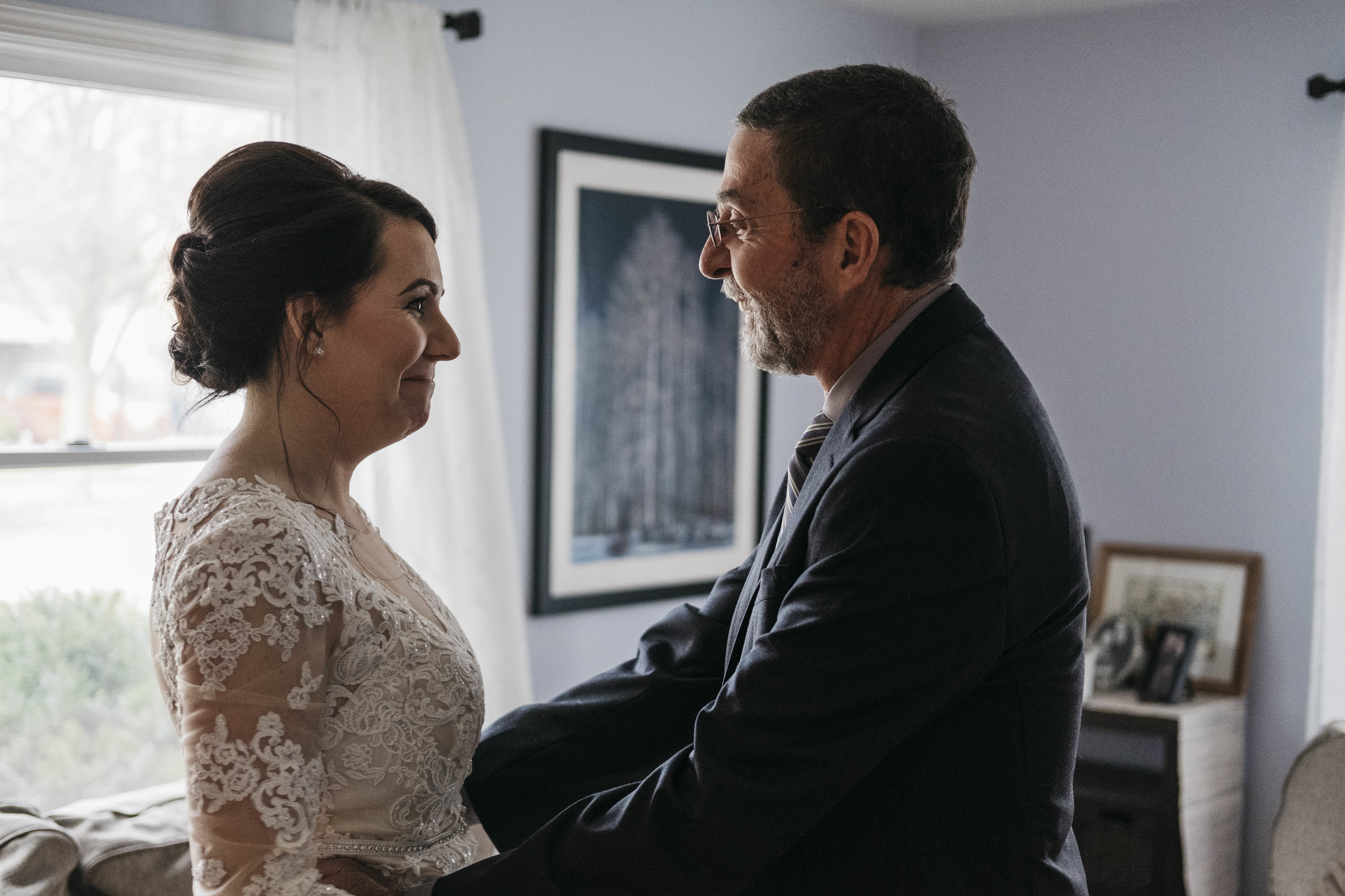 Bride and father have a first look before wedding ceremony.