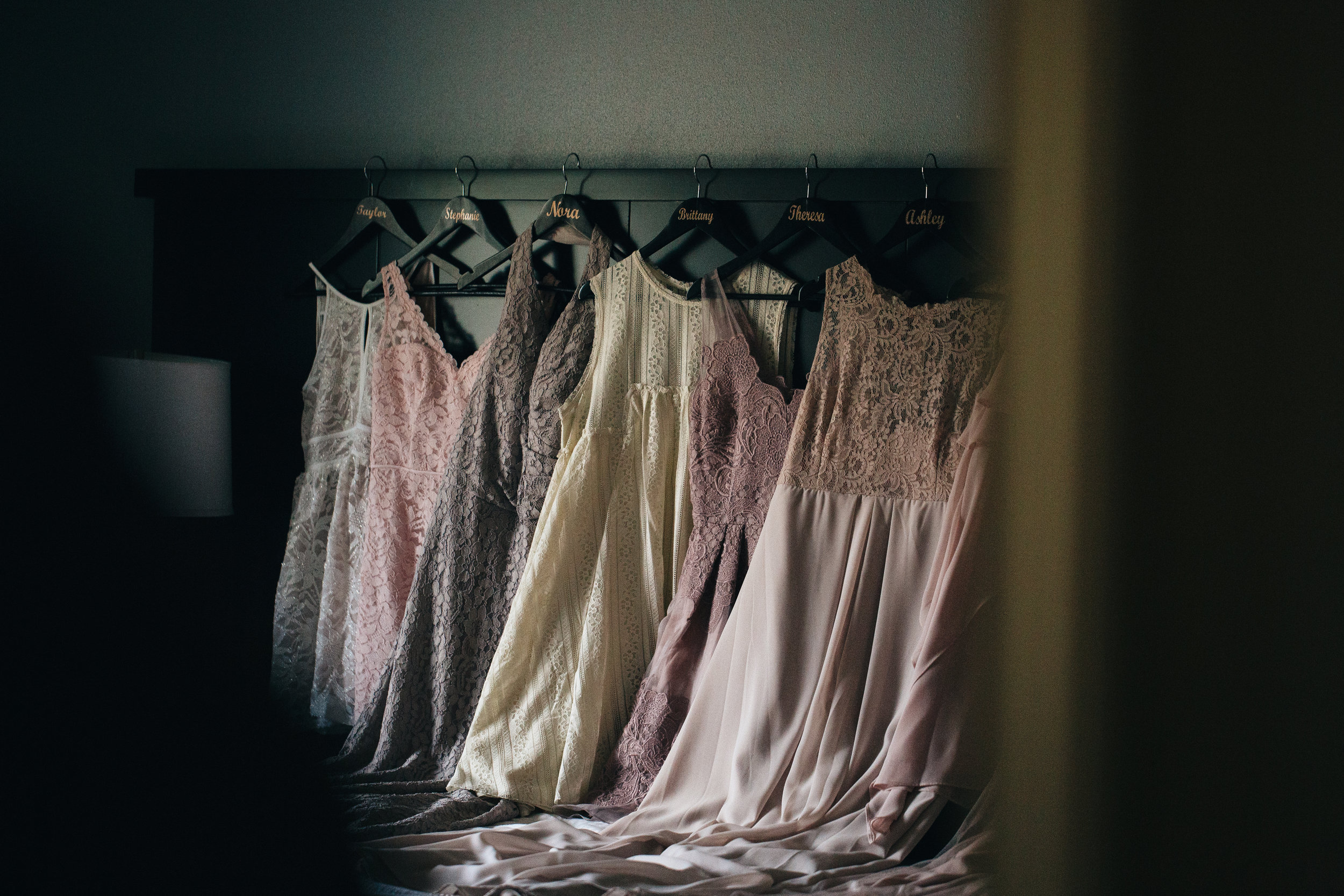 Bridesmaids dresses in different neutral and blush tones.
