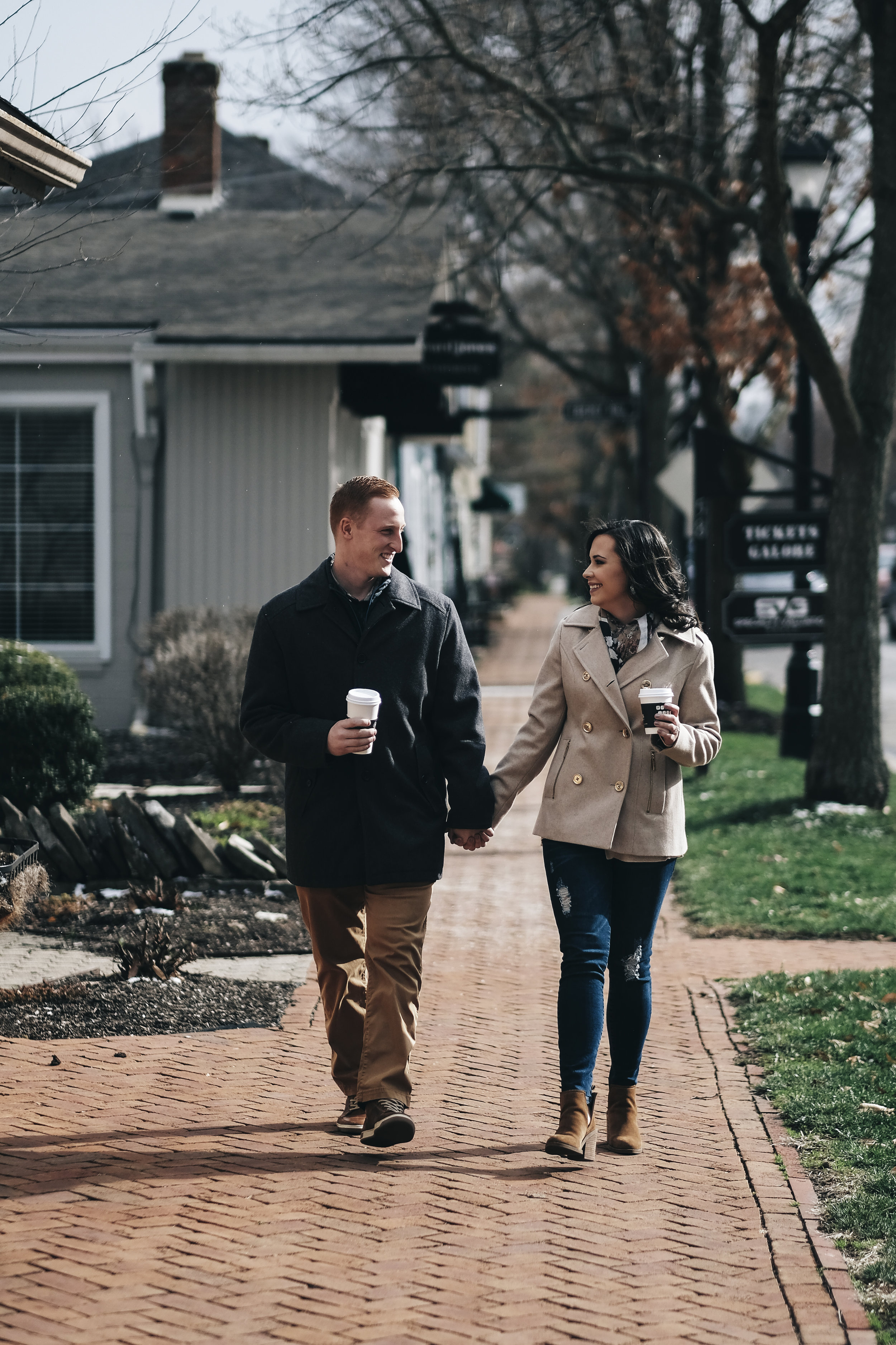 Couple walking during engagement session.