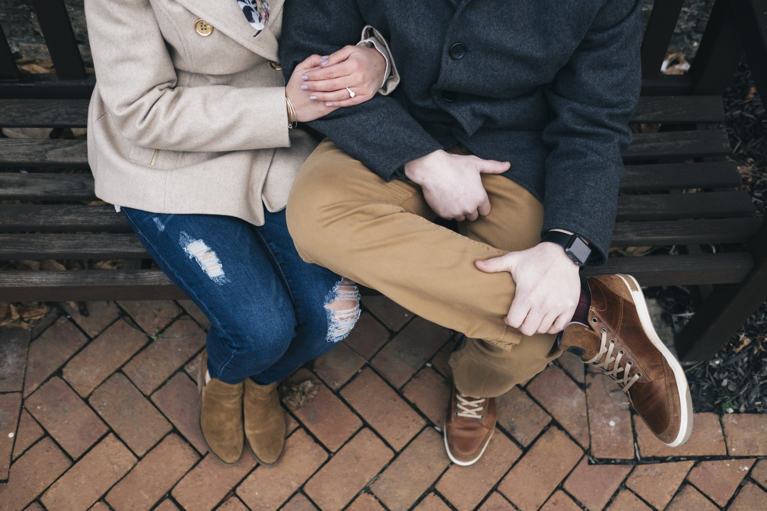 Couple cuddled up during winter engagement session.