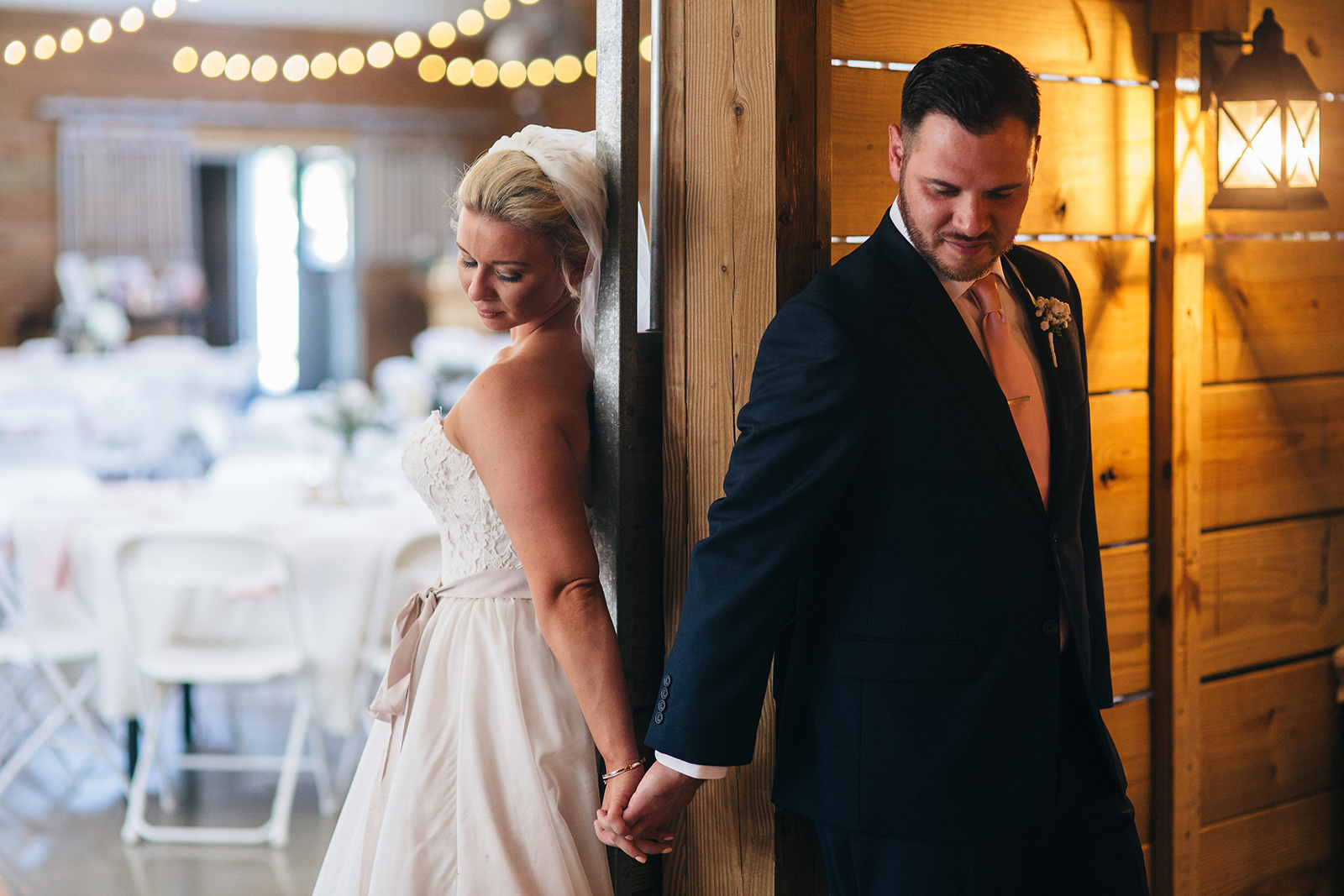Bride and groom holding hands before their wedding at The Stables in Whitehouse, Ohio.