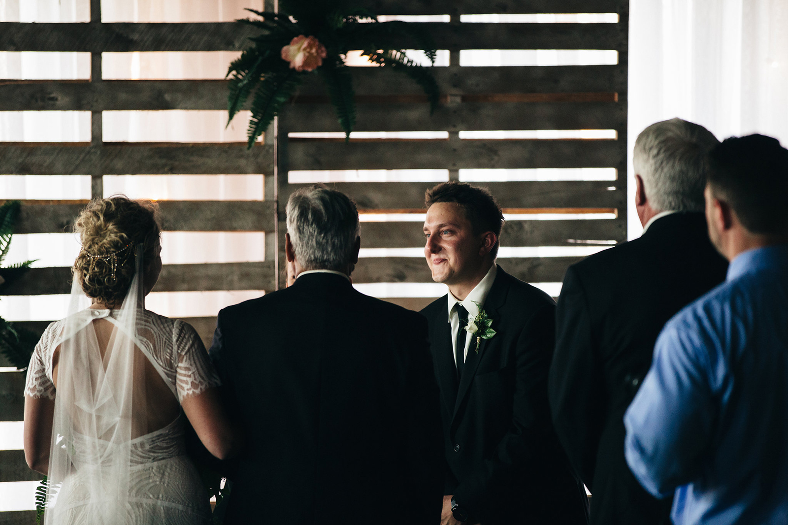 Bride and groom see each other for the first time during their wedding ceremony in Toledo, Ohio.